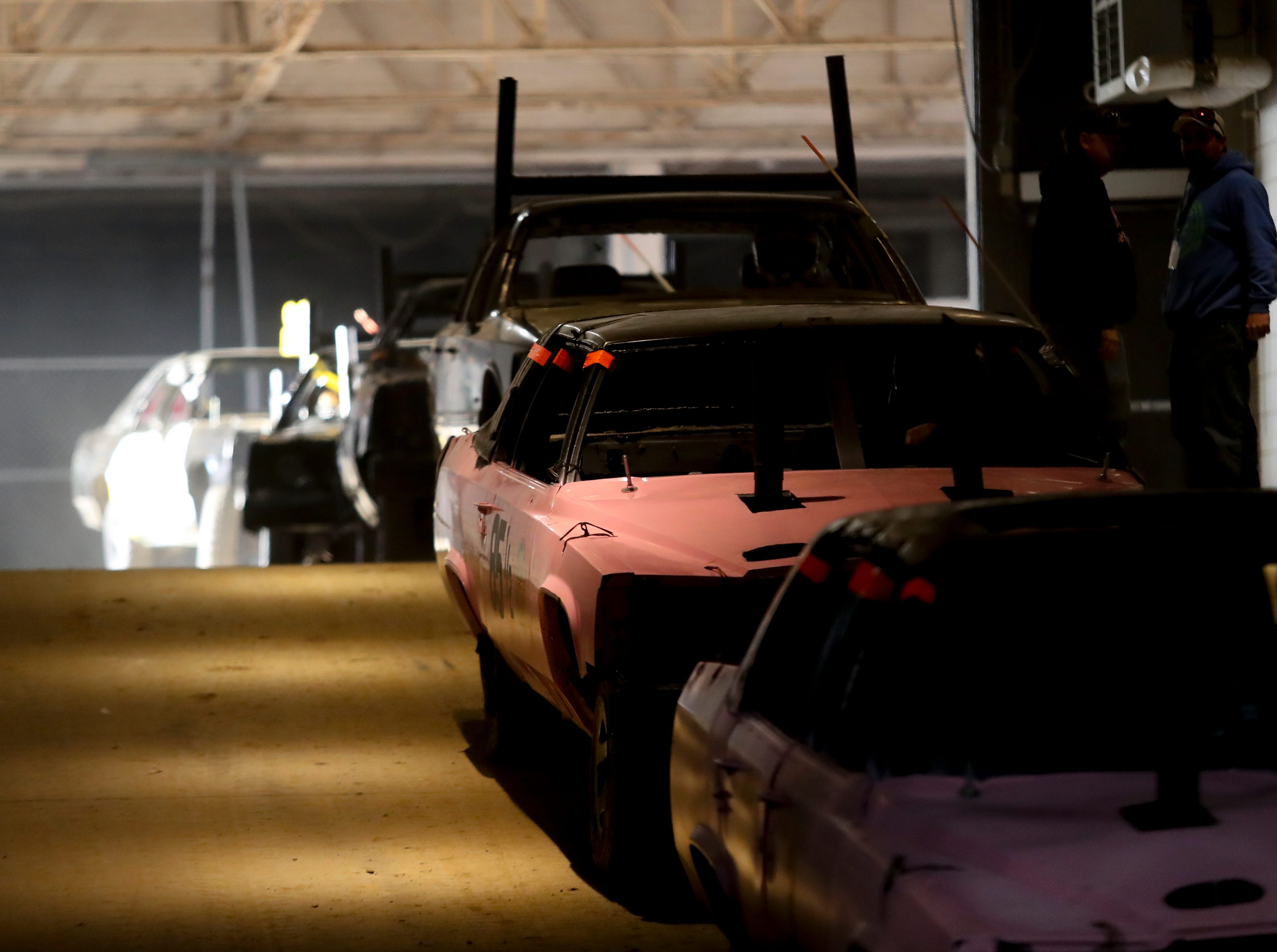 Competitors enter the arena at the 4th annual Bluegrass Bash Demolition Derby in Freedom Hall on March 23.
