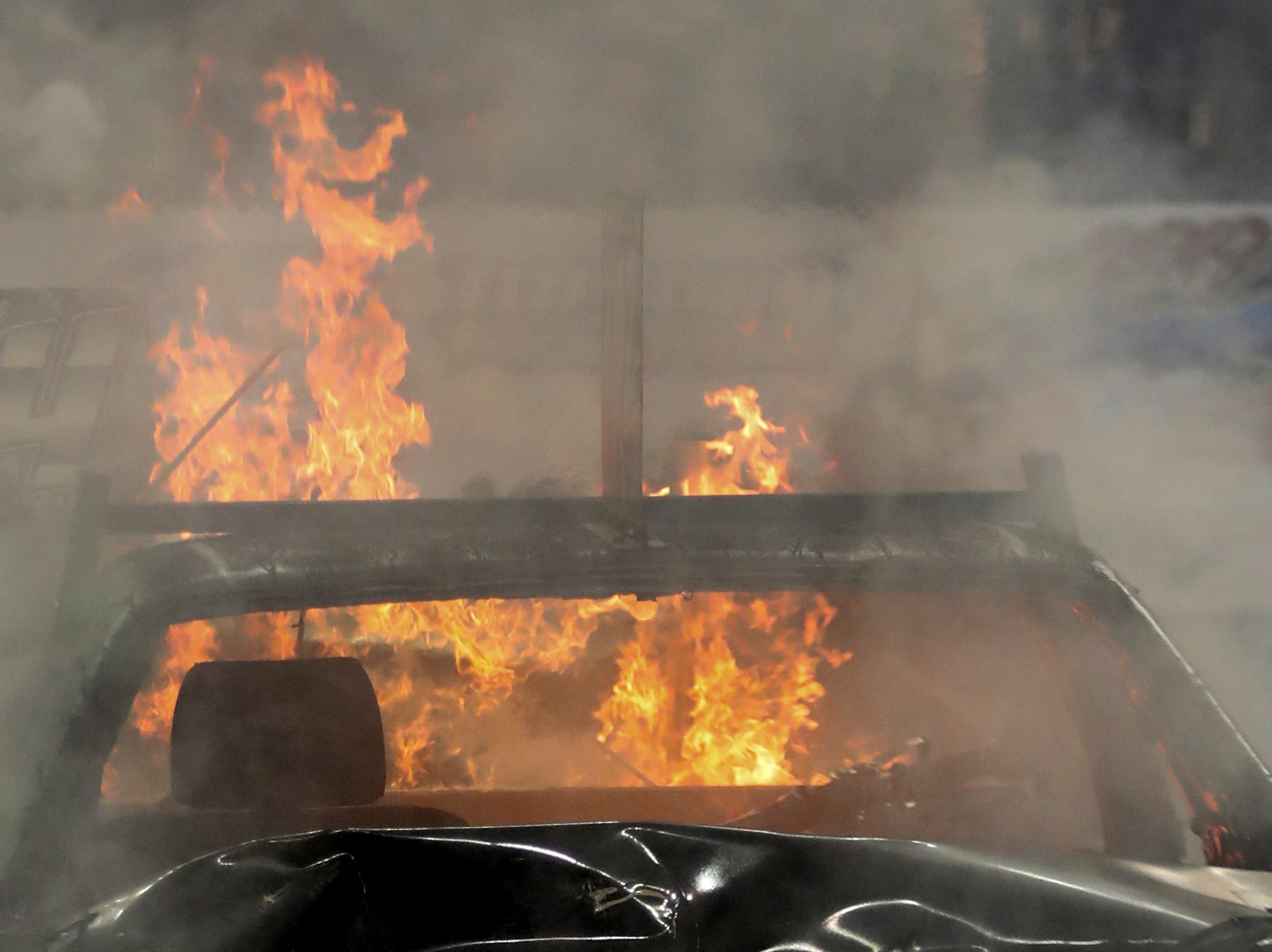 Tim Haniszewski's car goes up in flames at the 4th annual Bluegrass Bash Demolition Derby in Freedom Hall on March 23.
