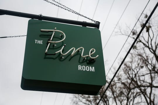 The sign for the Pine Room hangs at the Harrods Creek restaurant.