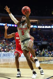 Houston Cougars guard Corey Davis Jr. (5) shoots the ball against the Ohio State Buckeyes during the first half in the second round of the 2019 NCAA Tournament.
