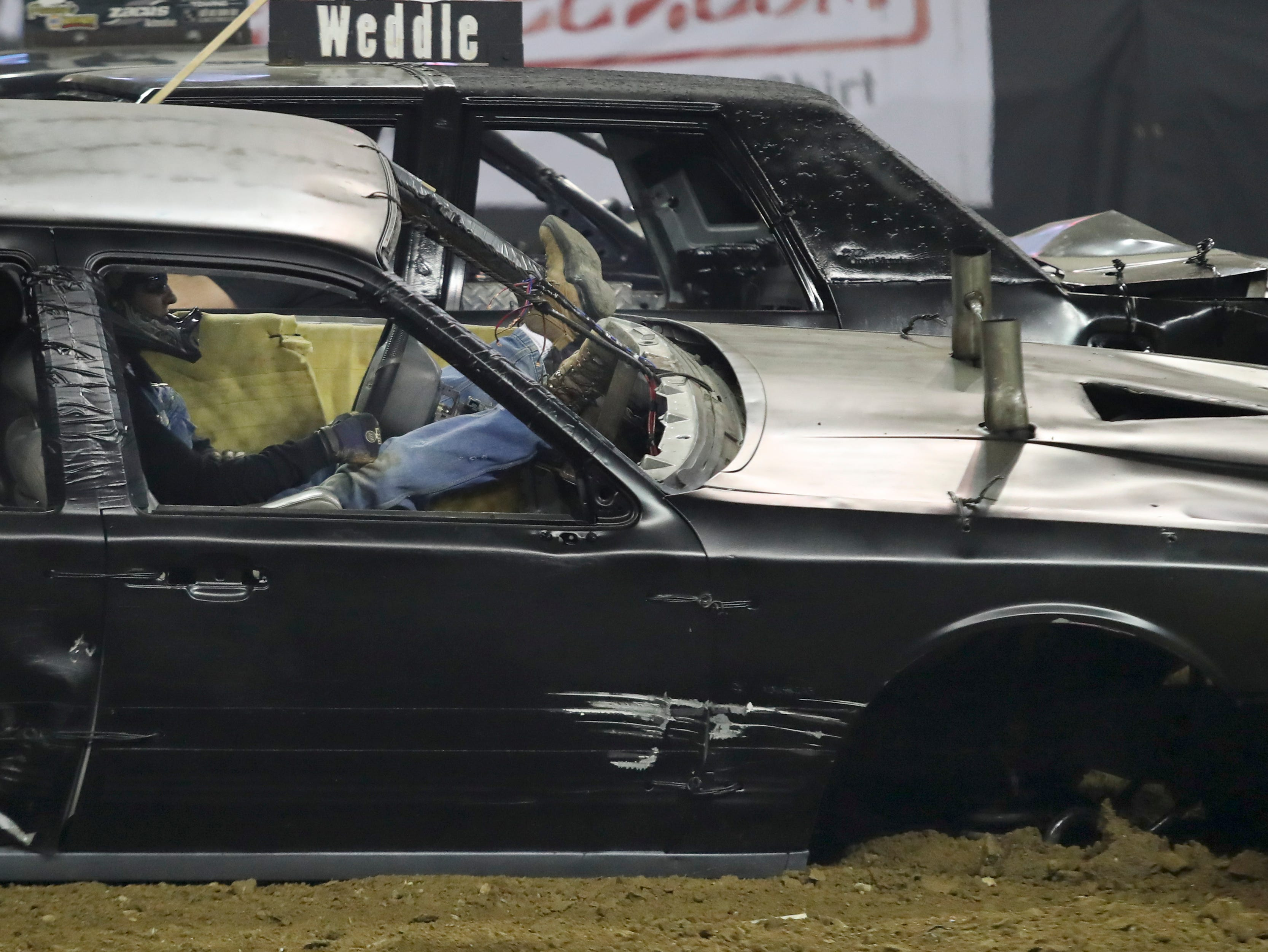 Drivers wait for the competition to end after their cars are rendered useless at the 4th annual Bluegrass Bash Demolition Derby in Freedom Hall on March 23.