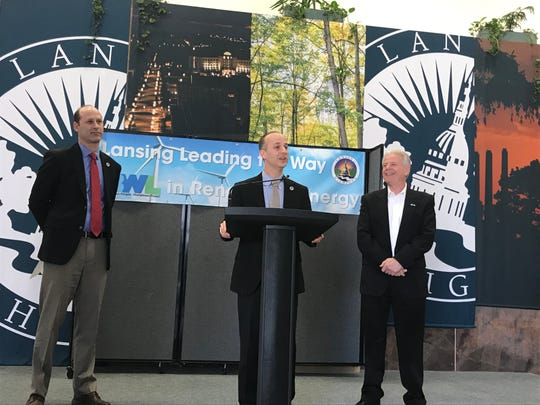From left, Lansing Public Service Director Andy Kilpatrick, Lansing Mayor Andy Schor and Lansing Board of Water & Light General Manager Dick Peffley attend a news conference Monday, March 25, 2019 at Lansing City Hall. Schor announced plans to use 100 percent renewable energy to power all city facilities.