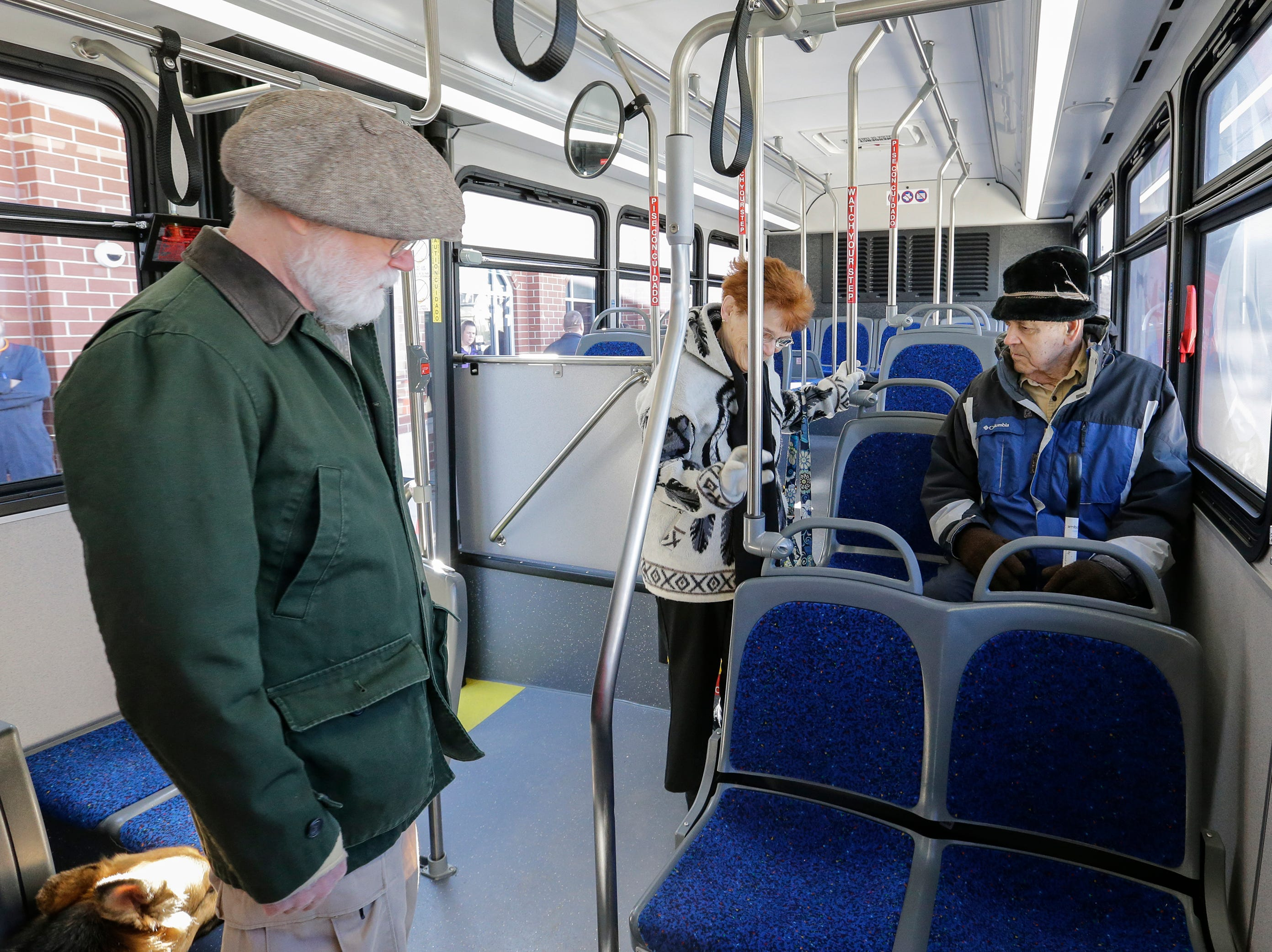 Claudia and Neil Halonen, right, of the Manitowoc Transit Commission, try out the seats on a new city bus at Maritime Metro Transit Monday, March 25, 2019, in Manitowoc, Wis. The new buses feature better fuel economy, lower emissions, an updated video surveillance system, an automatic securement system for people with disabilities and the capability to incorporate a real-time transit app for mobile devices which the city hopes to implement in the future. The buses go into service today, replacing old buses with more than 600,000 miles purchased between 2004 and 2005. Joshua Clark/USA TODAY NETWORK-Wisconsin