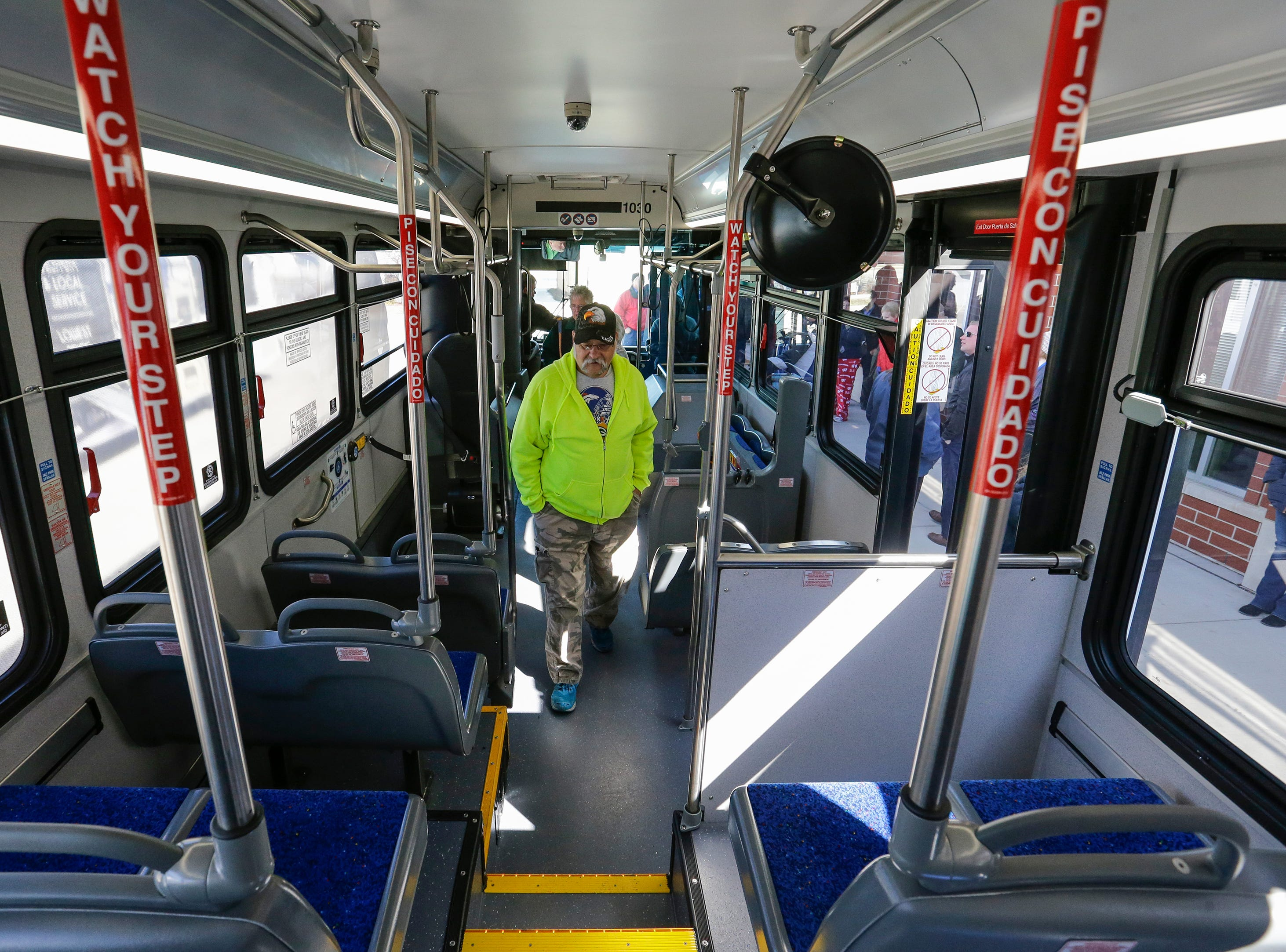People tour a new city bus commissioned for Maritime Metro Transit Monday, March 25, 2019, in Manitowoc, Wis. The new buses feature better fuel economy, lower emissions, an updated video surveillance system, an automatic securement system for people with disabilities and the capability to incorporate a real-time transit app for mobile devices which the city hopes to implement in the future. The buses go into service today, replacing old buses with more than 600,000 miles purchased between 2004 and 2005. Joshua Clark/USA TODAY NETWORK-Wisconsin