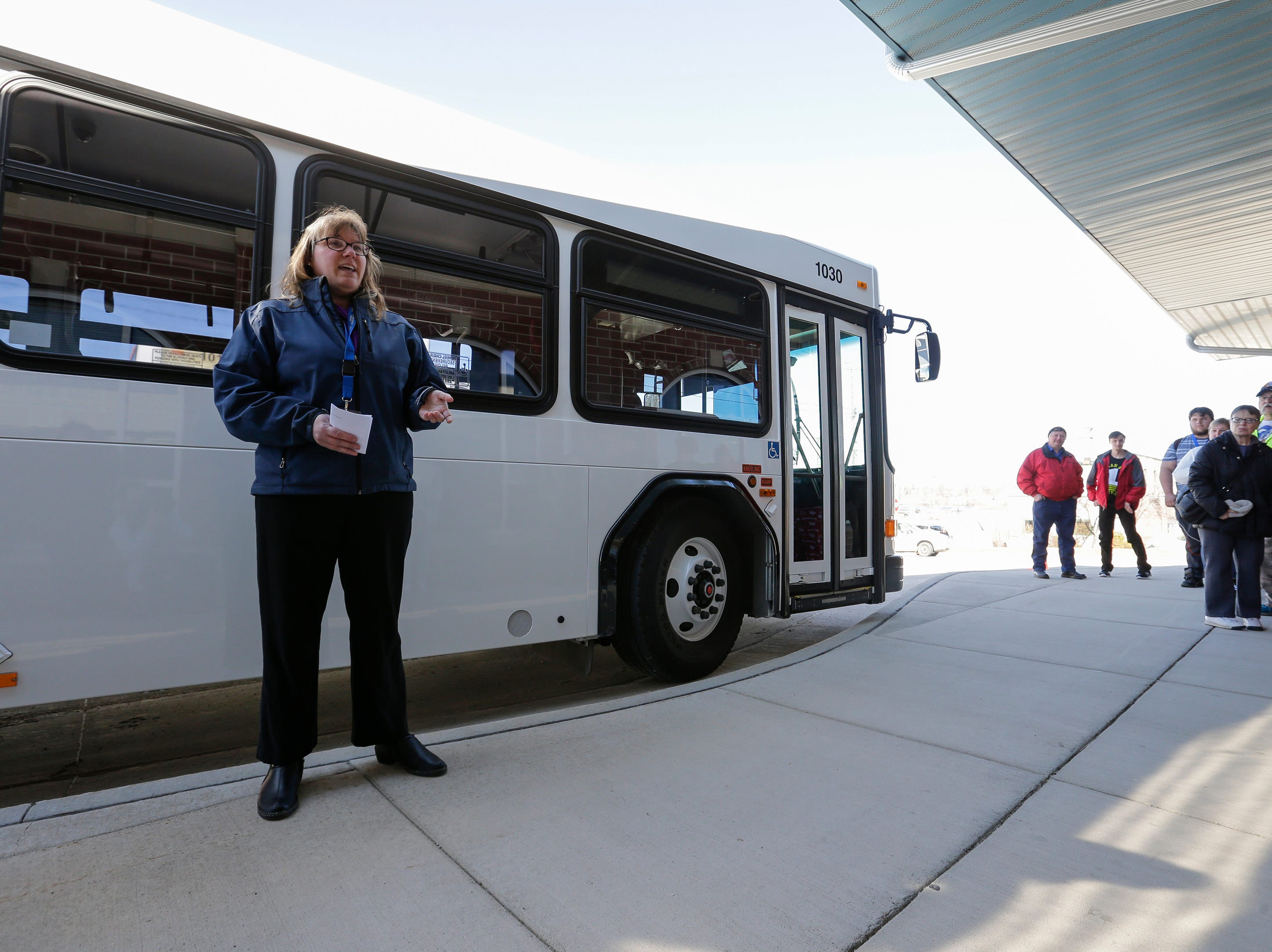 Maritime Metro Transit interim manager Marlo Kohlmann introduces one of six new city buses outside the Maritime Metro Transit transfer station Monday, March 25, 2019, in Manitowoc, Wis. The new buses feature better fuel economy, lower emissions, an updated video surveillance system, an automatic securement system for people with disabilities and the capability to incorporate a real-time transit app for mobile devices which the city hopes to implement in the future. The buses go into service today, replacing old buses with more than 600,000 miles purchased between 2004 and 2005. Joshua Clark/USA TODAY NETWORK-Wisconsin