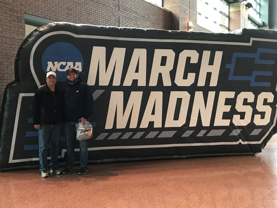 Mansfield News Journal Sports Reporter Jake Furr and his father, Jerry Furr, stand for a photo during the first day of the NCAA March Madness tournament in Columbus on Friday.