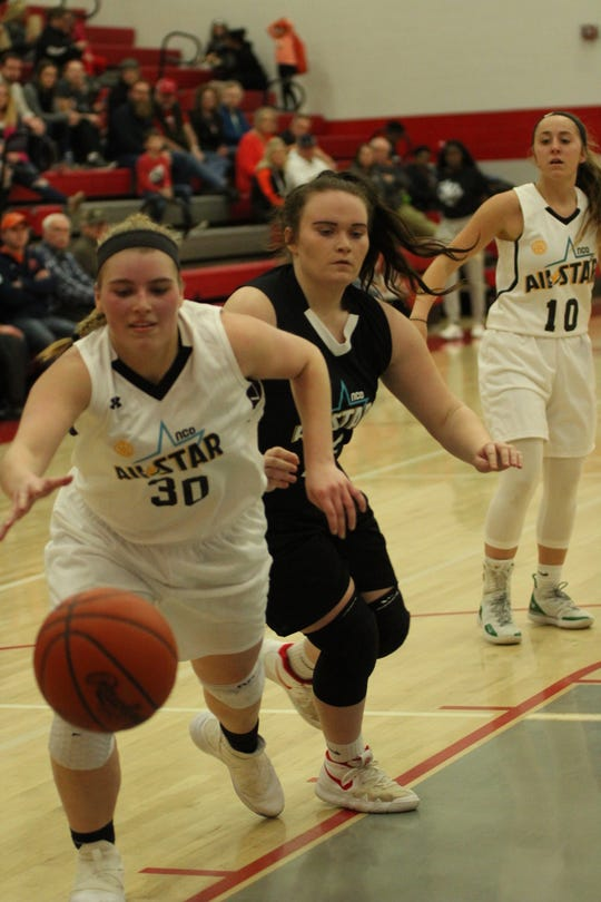 Shelby's Bailey Walter chases down a loose ball during all-star action on her home court Sunday. Walter earned MVP honors by scoring 26 points and rallying Team White to a victory in the seniors game.