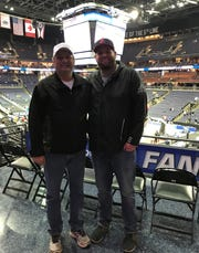 Mansfield News Journal Sports Reporter Jake Furr stands with his father, Jerry Furr, during the second round of the NCAA March Madness tournament on Sunday.