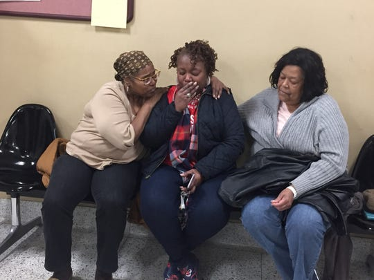 Denise Hawkins, left, comforts Stacey Young after hearing the verdict in the Khairi Bond murder trial on Monday. Barbara Briggs is on the right. All of them are aunts of victim Nolan Lovett.