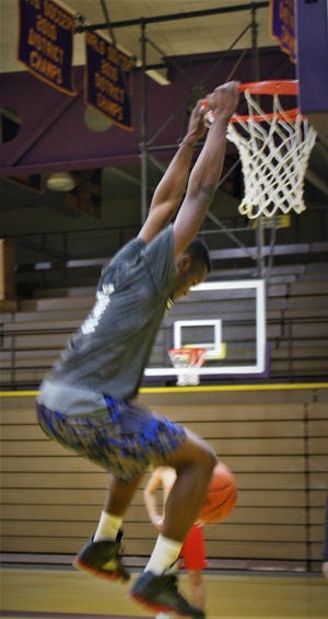 Willard's Davon Triplett dunks while practicing with the North for Friday's 41st News Journal All-Star Basketball Classic at Lexington High School.