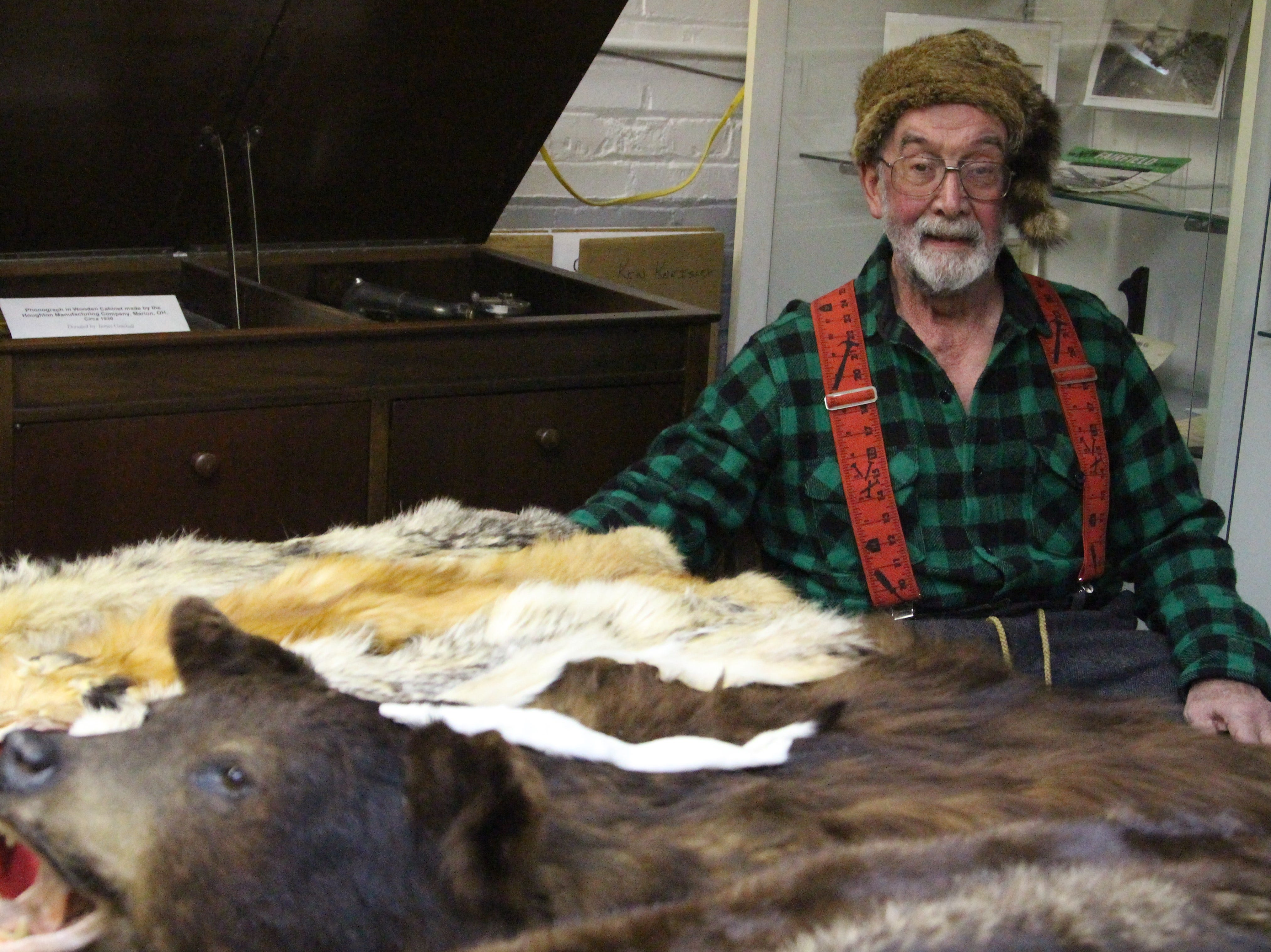 """Dick Cooper sits next to a table of pelts representing some of the local wild life. He portrayed his great-great-great grandfather Daniel Cooper Friday night during """"A night at Heritage Hall,"""" which showcased figures from Marion's and Ohio's past."""