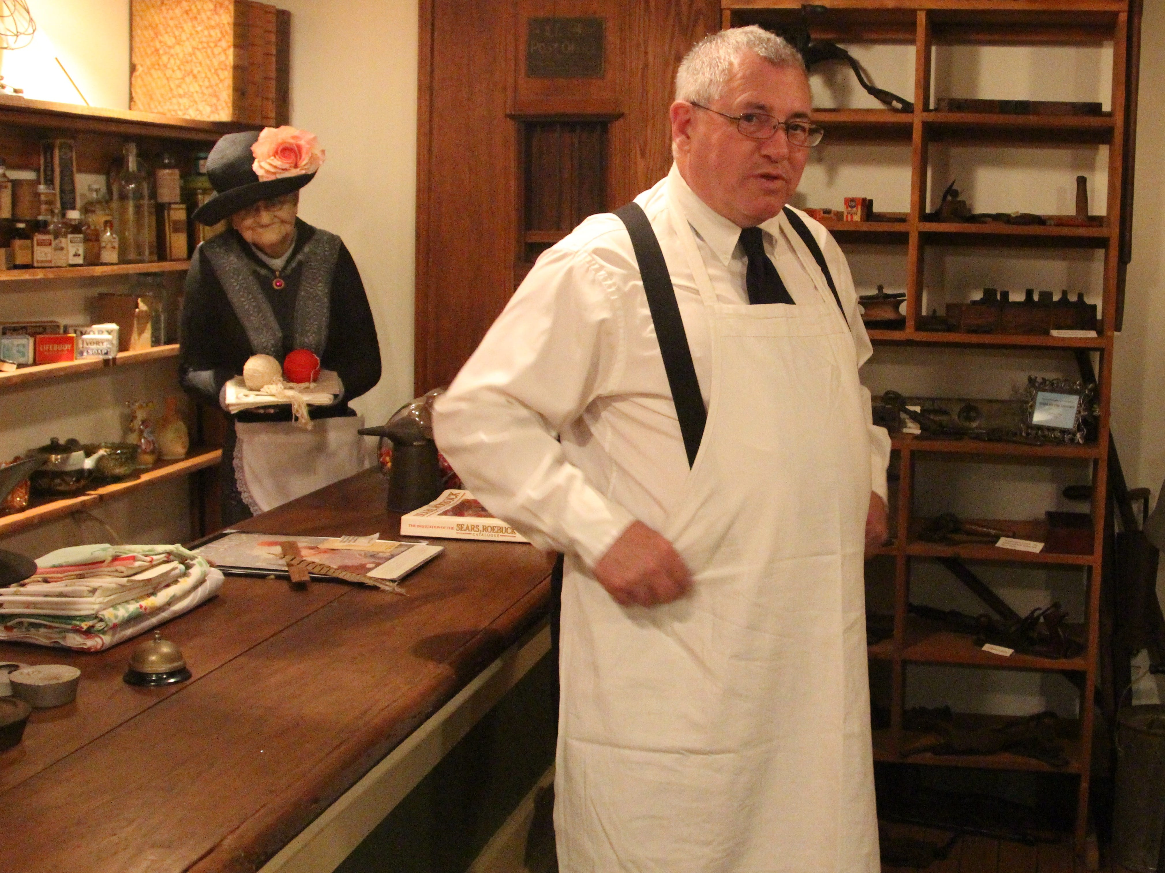 Mike Wilson portrays his great uncle and butcher Alfred Harvey Wilson in the lower level of heritage hall on Friday. Stationed in a mock-up of a general store of Marion's past, he greeted guest who roamed the museum with a flashlight and a map.