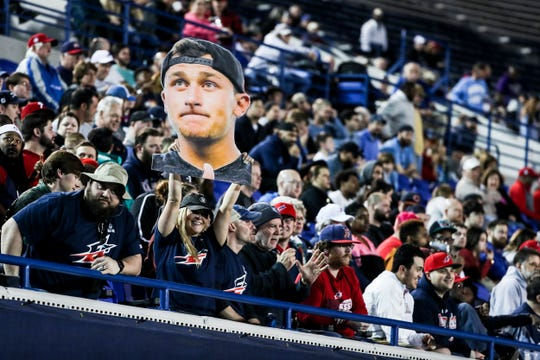 A fan holds a picture of Johnny Manziel during Sunday night's game against the Birmingham Iron at Liberty Bowl Memorial Stadium.