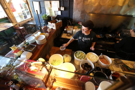 Sous Chef Gally Sheedy works in the kitchen at the Crazy Noodle in Midtown on Thursday, March 21, 2019.
