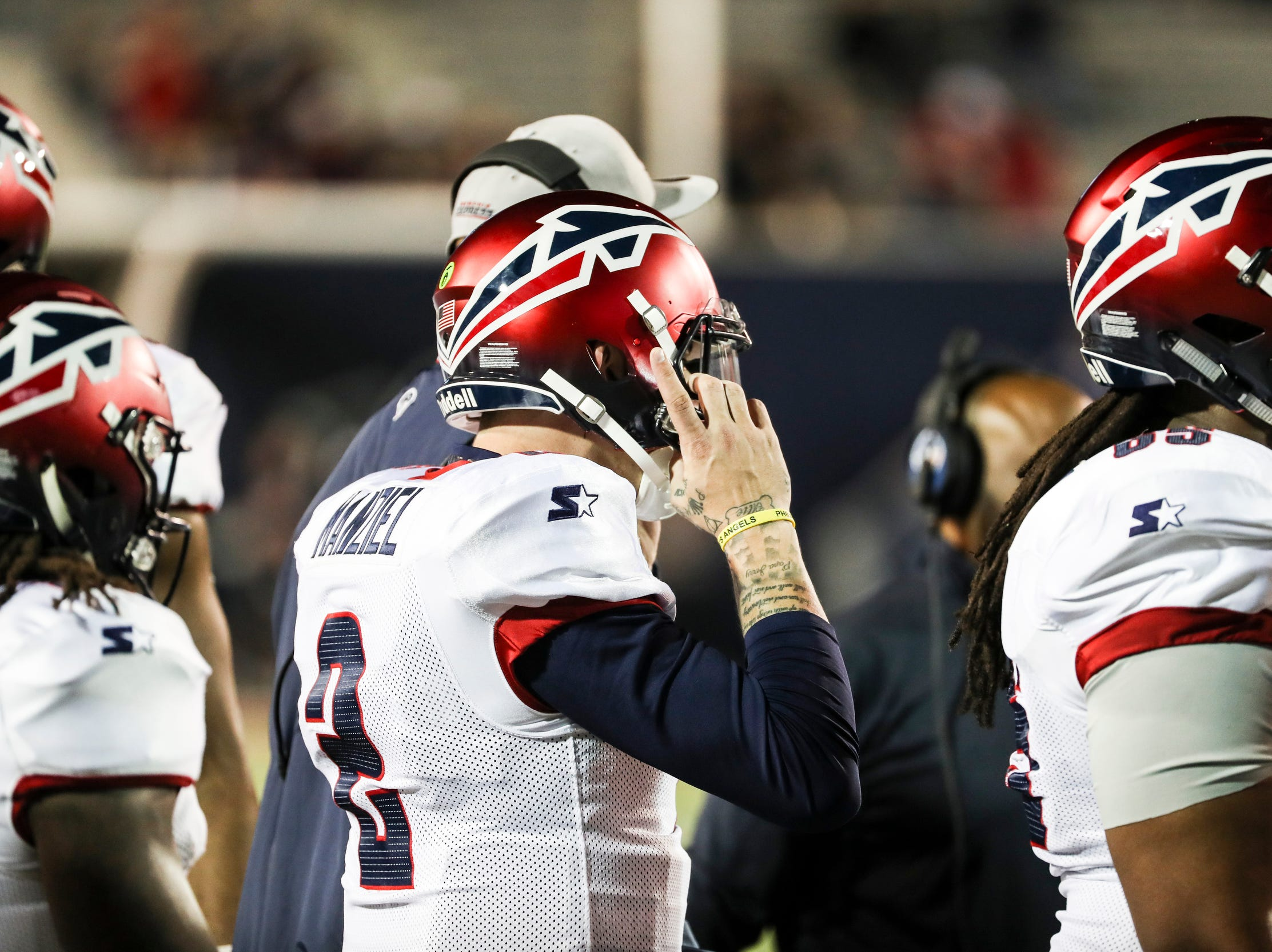 March 24, 2019 - Johnny Manziel adjusts his helmet before entering Sunday night's game against the Birmingham Iron at the Liberty Bowl Memorial Stadium.