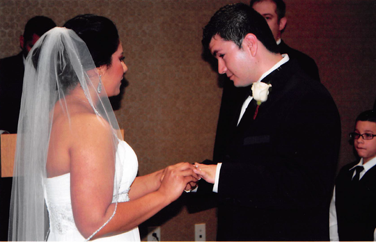 Carmen Puerto Diaz and her husband on their wedding day, April 28, 2011. Puerto Diaz was five months into a high-risk pregnancy when she was arrested and detained by Immigration and Customs Enforcement officials in January.