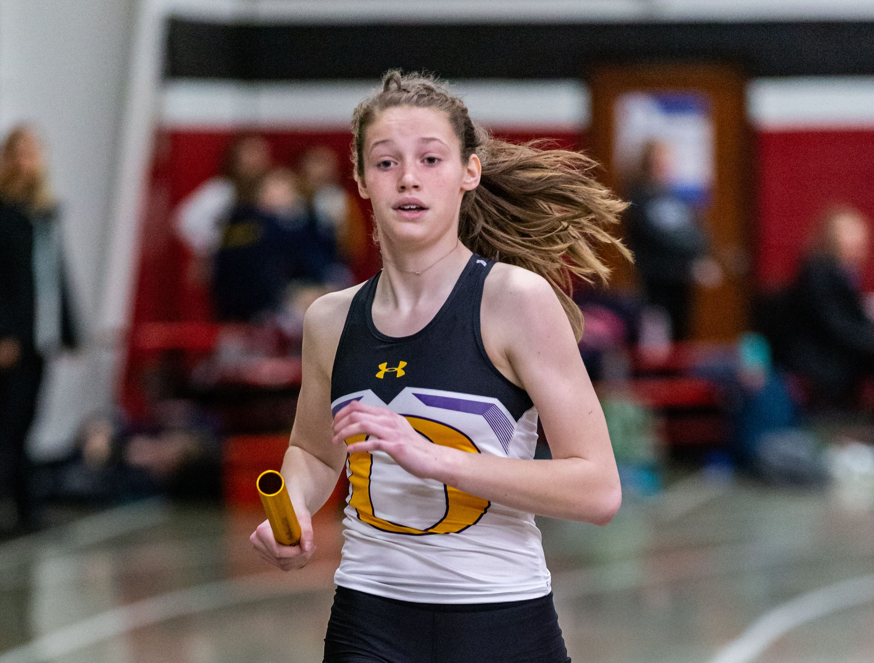 Oconomowoc's Megan Frosch competes in the 4x440 yard relay at the Peter Rempe Cardinal Relays hosted by Waukesha South on Thursday, March 21, 2019.