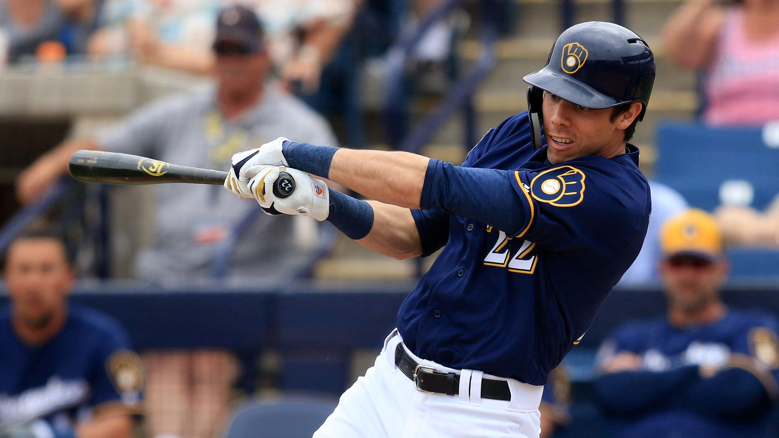 Milwauke Brewers Christain Yelich follows through on a swing during their spring training game against the Los Angeles Dodgers, Thursday, March 21, 2019, in Phoenix, Arizona.(Photo/Roy Dabner) ORG XMIT: RD255