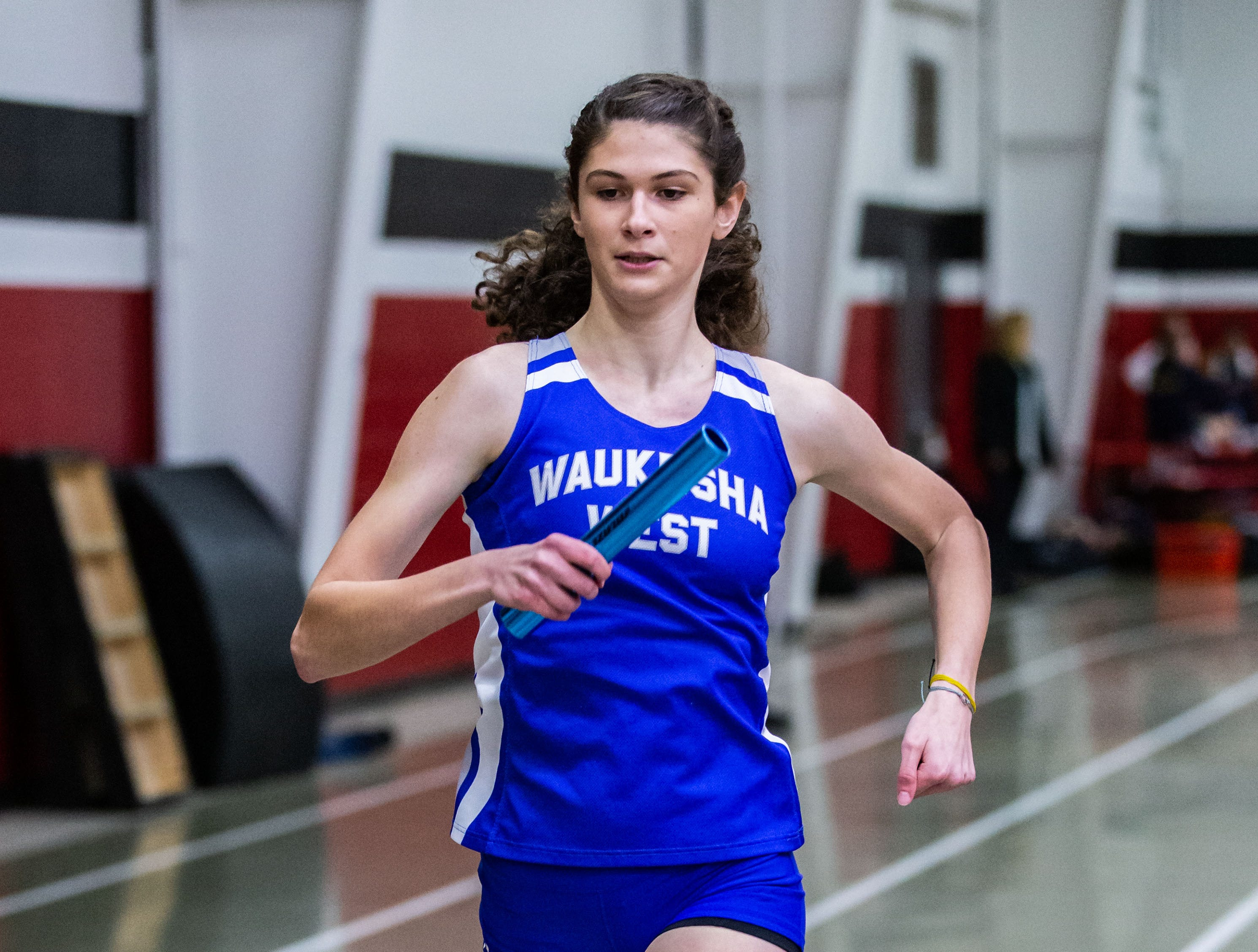 Waukesha West's Erin Phelan competes in the 4x440 yard relay at the Peter Rempe Cardinal Relays hosted by Waukesha South on Thursday, March 21, 2019. West won the event with a time of 4:21.90.