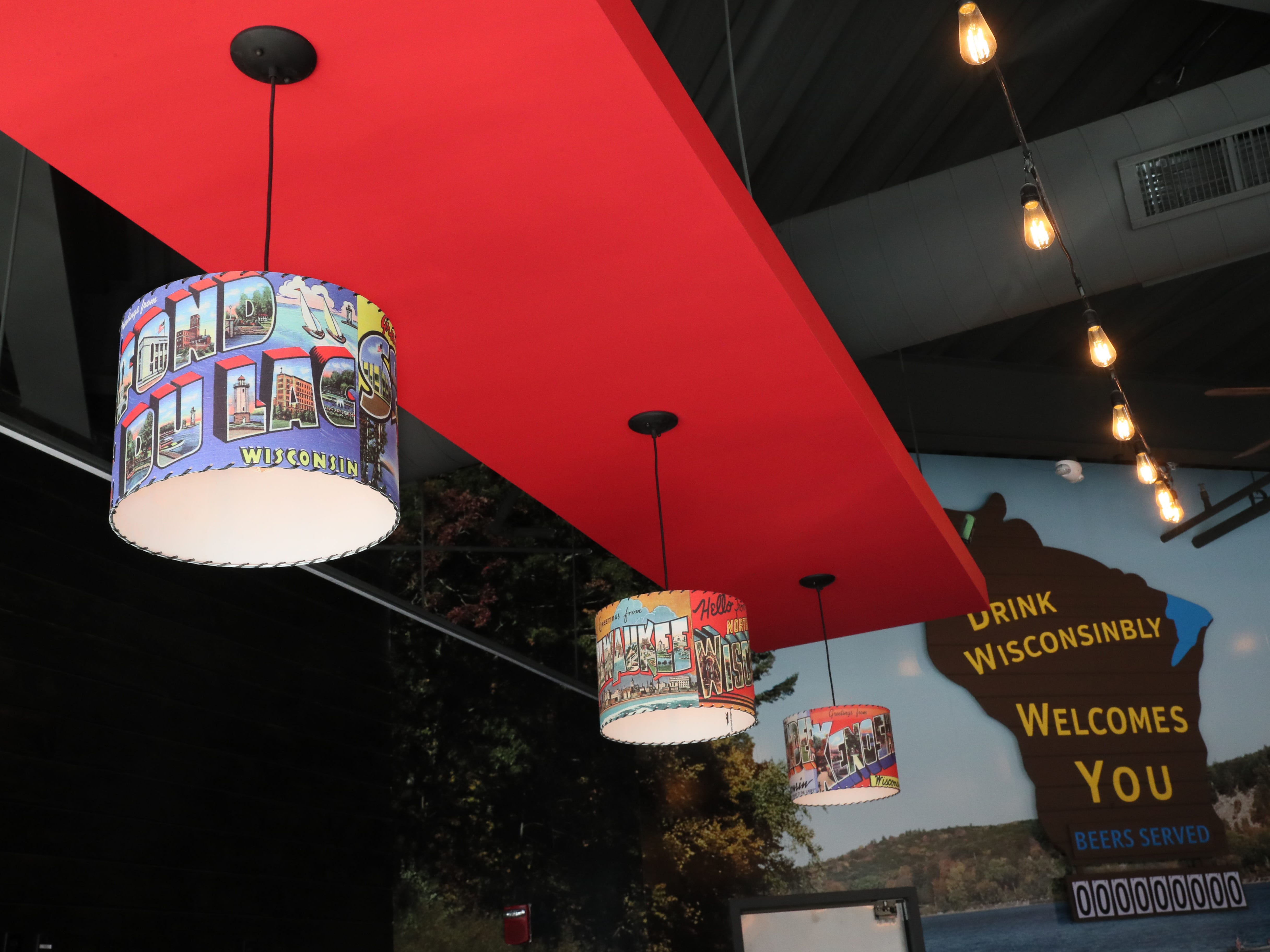 Custom lampshades above the bar bear the names of Wisconsin cities.