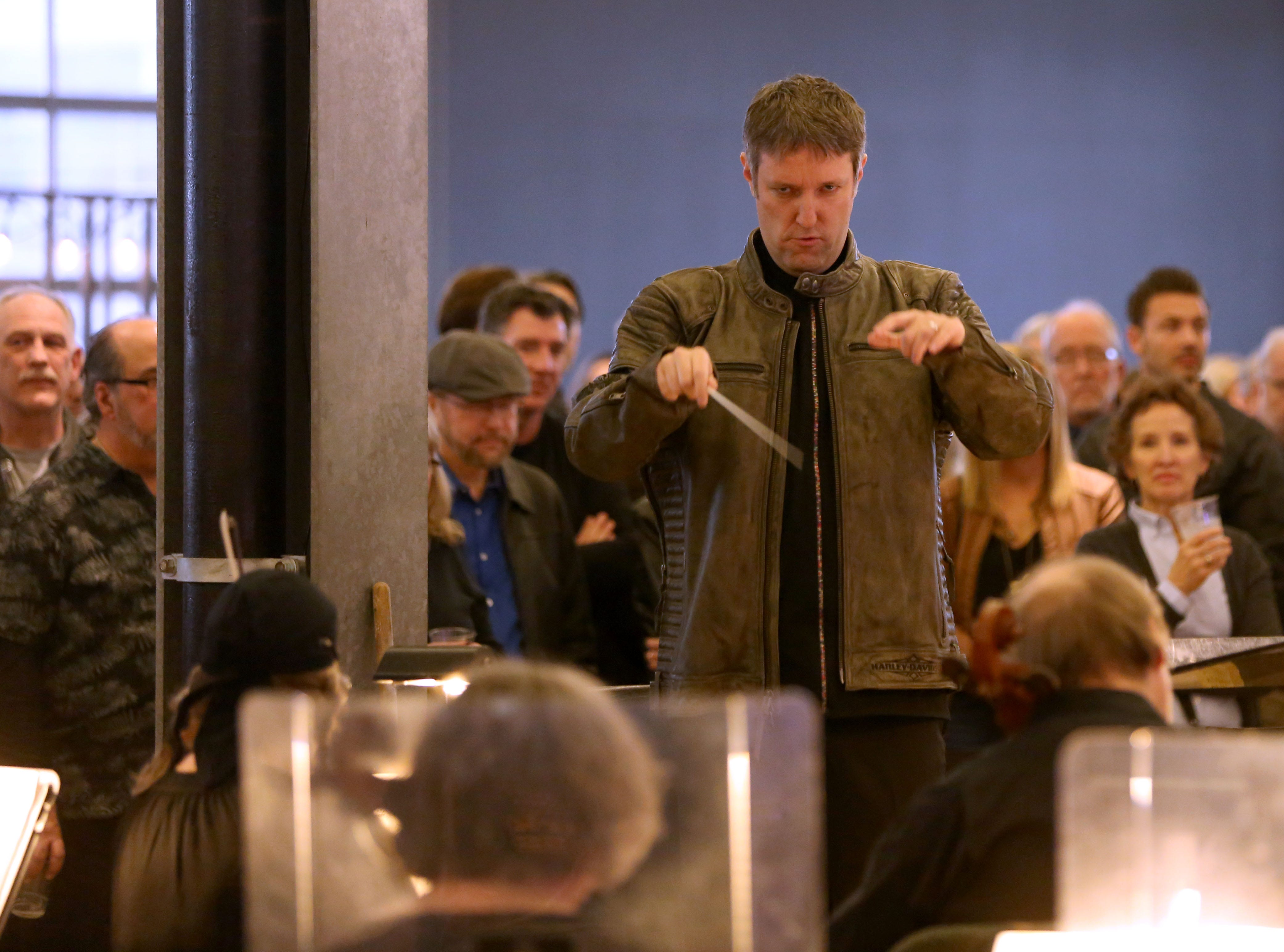 Yaniv Dinur leads the Milwaukee Symphony during their Secret Symphony performance Sunday at the Harley-Davidson Museum.