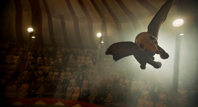 """The baby elephant with the oversize ears soars above the center ring in """"Dumbo."""""""