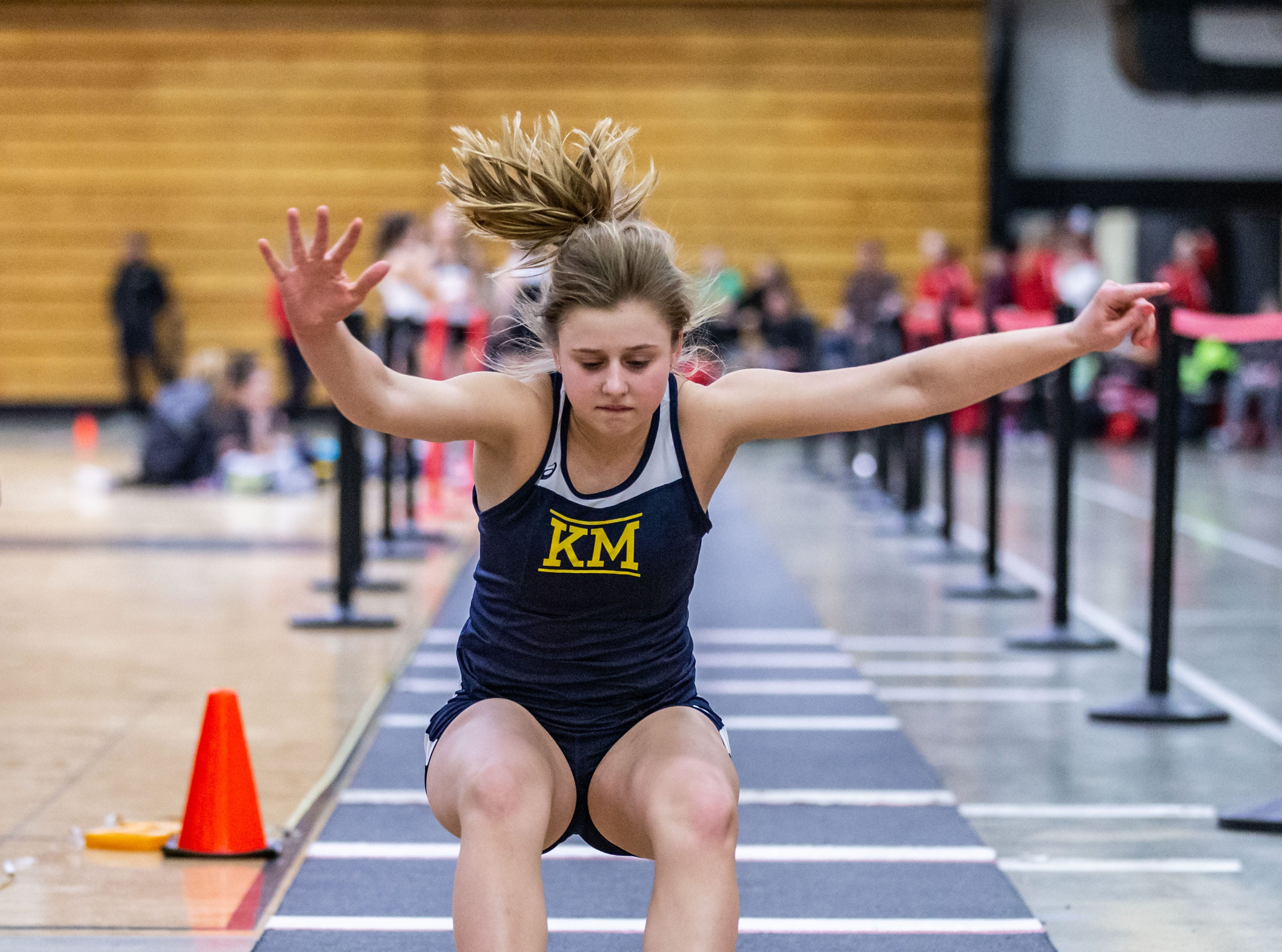 Kettle Moraine's Kaitlyn Huebner competes in the long jump at the Peter Rempe Cardinal Relays hosted by Waukesha South on Thursday, March 21, 2019.