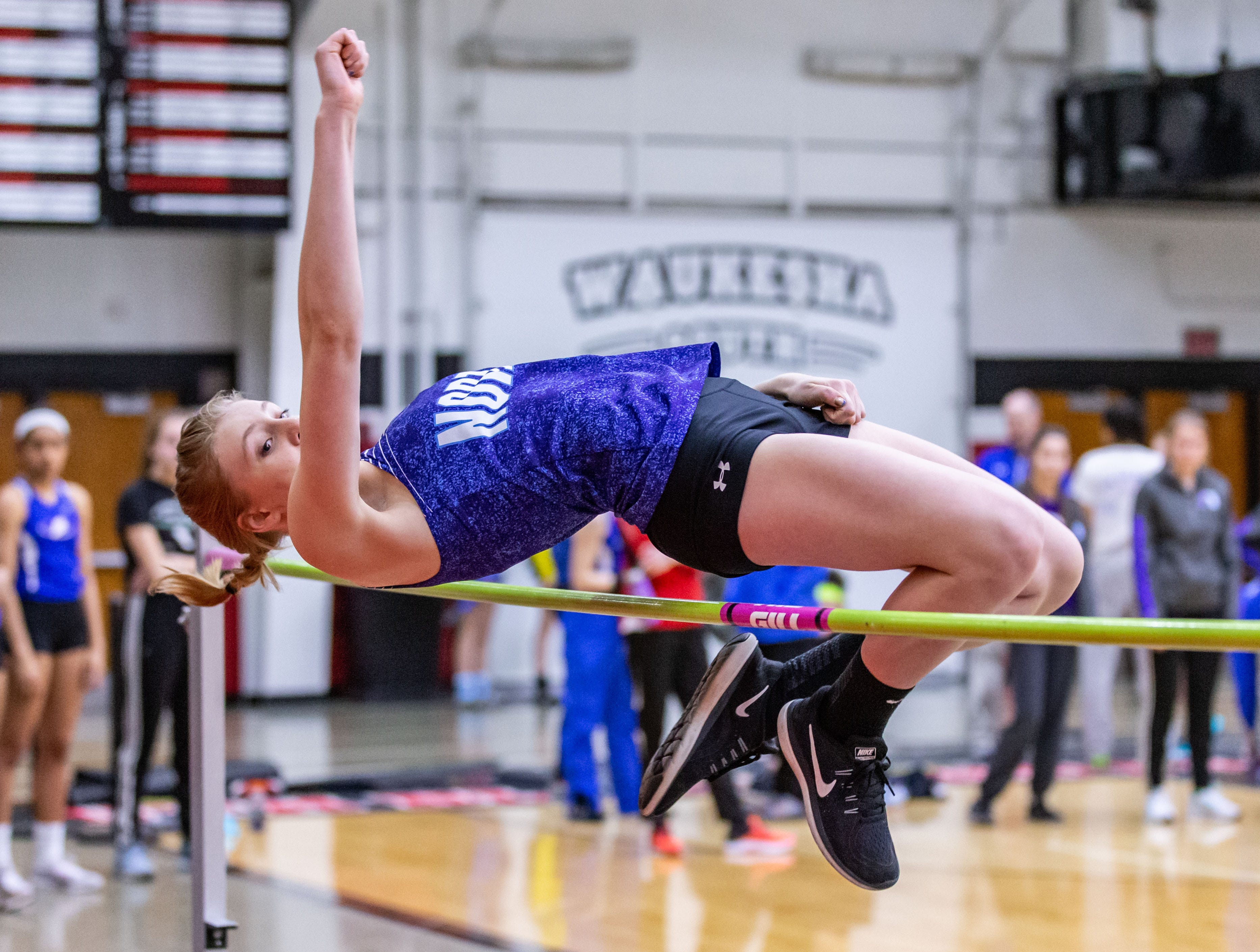 Waukesha North's Kaitlyn Curtis competes in the high jump at the Peter Rempe Cardinal Relays hosted by Waukesha South on Thursday, March 21, 2019.
