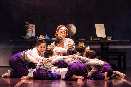 """Anna (Angela Baumgardner) dotes on the royal children in the national touring company of """"The King and I."""" The musical visits Springfield's Hammons Hall for the Performing Arts April 2-4."""
