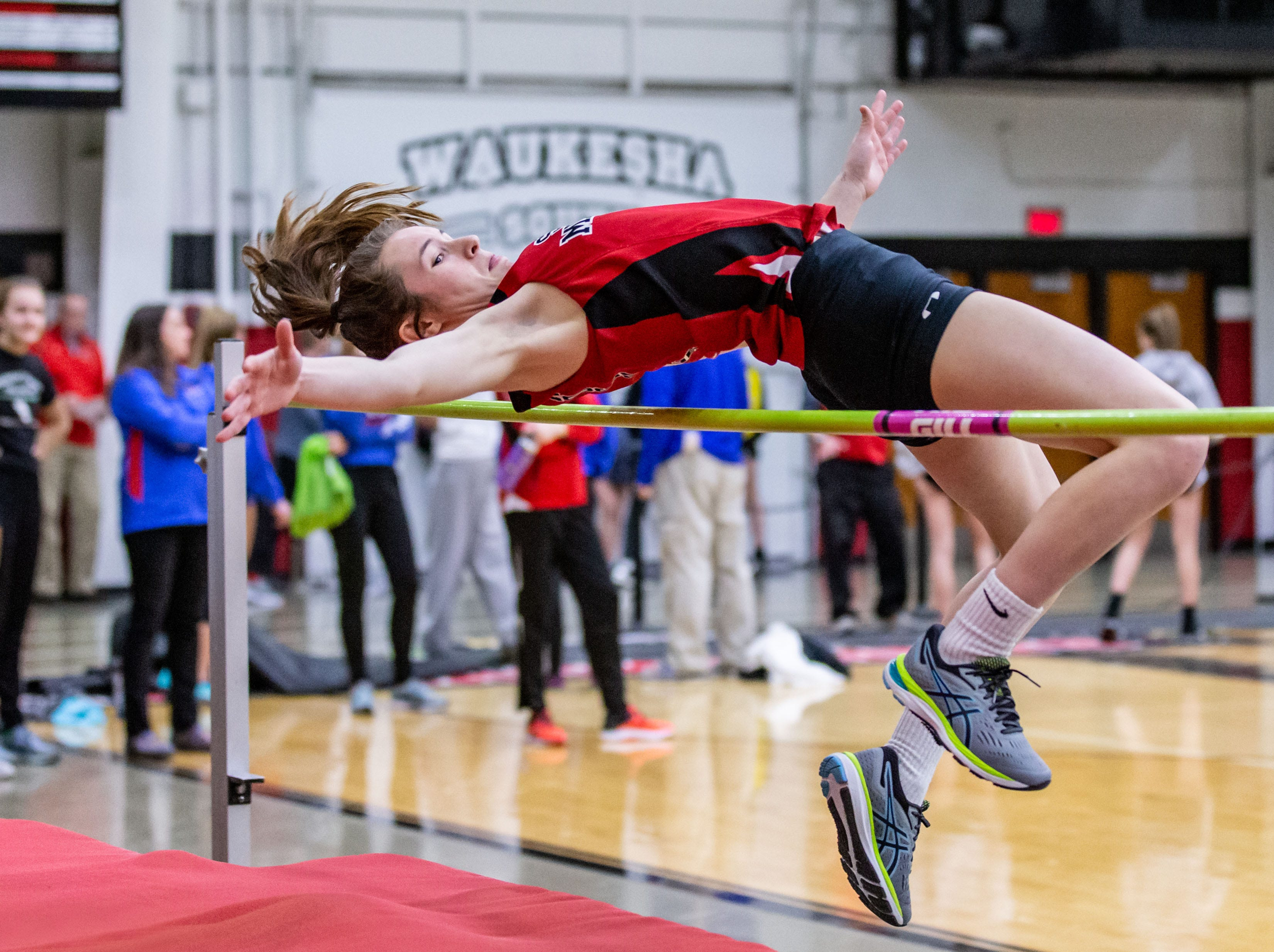 South Milwaukee's Keegan Schell competes in the high jump at the Peter Rempe Cardinal Relays hosted by Waukesha South on Thursday, March 21, 2019.