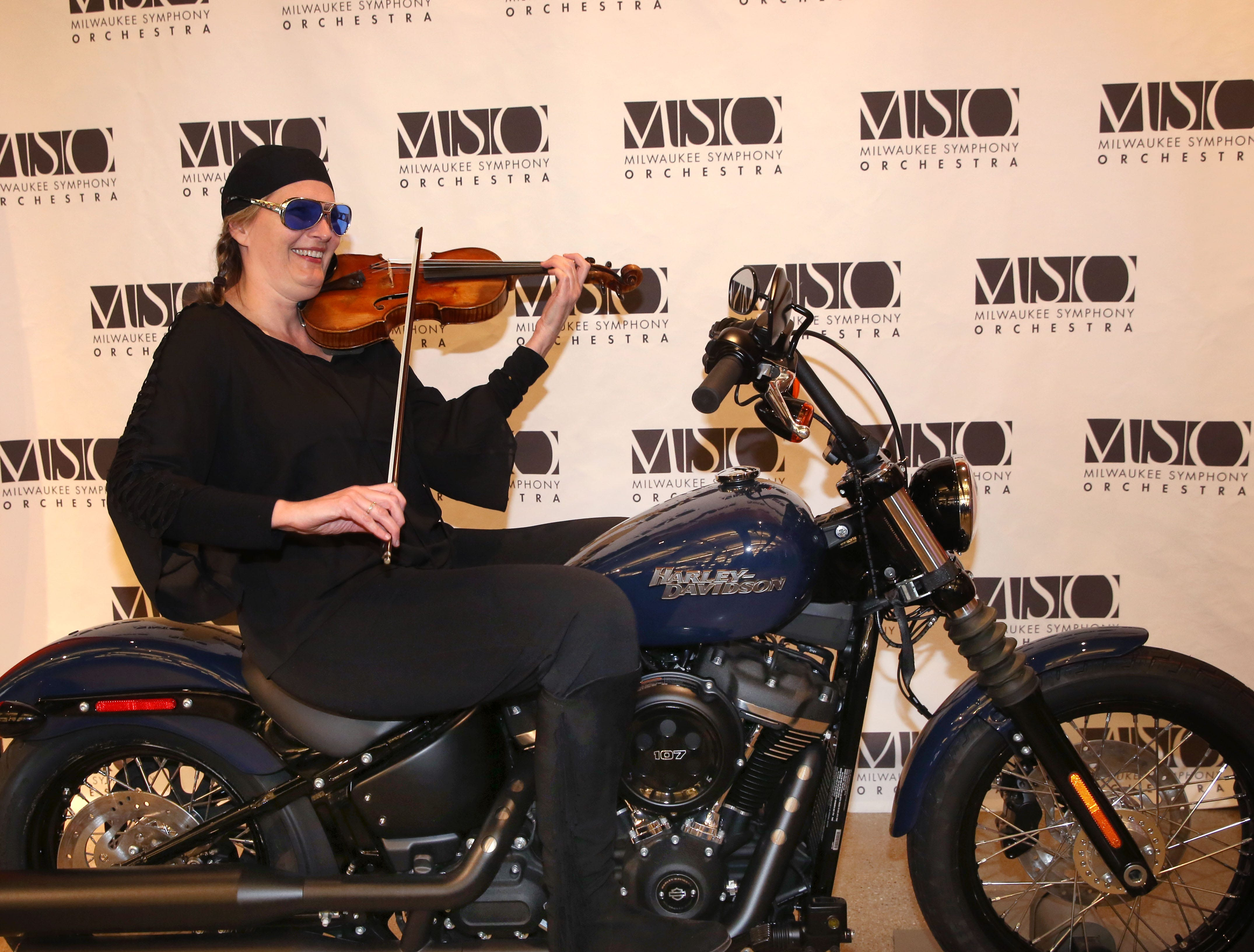 Violinist Lisa Johnson Fuller warms up before the Milwaukee Symphony's Secret Symphony performance at the Harley-Davidson Museum Sunday.