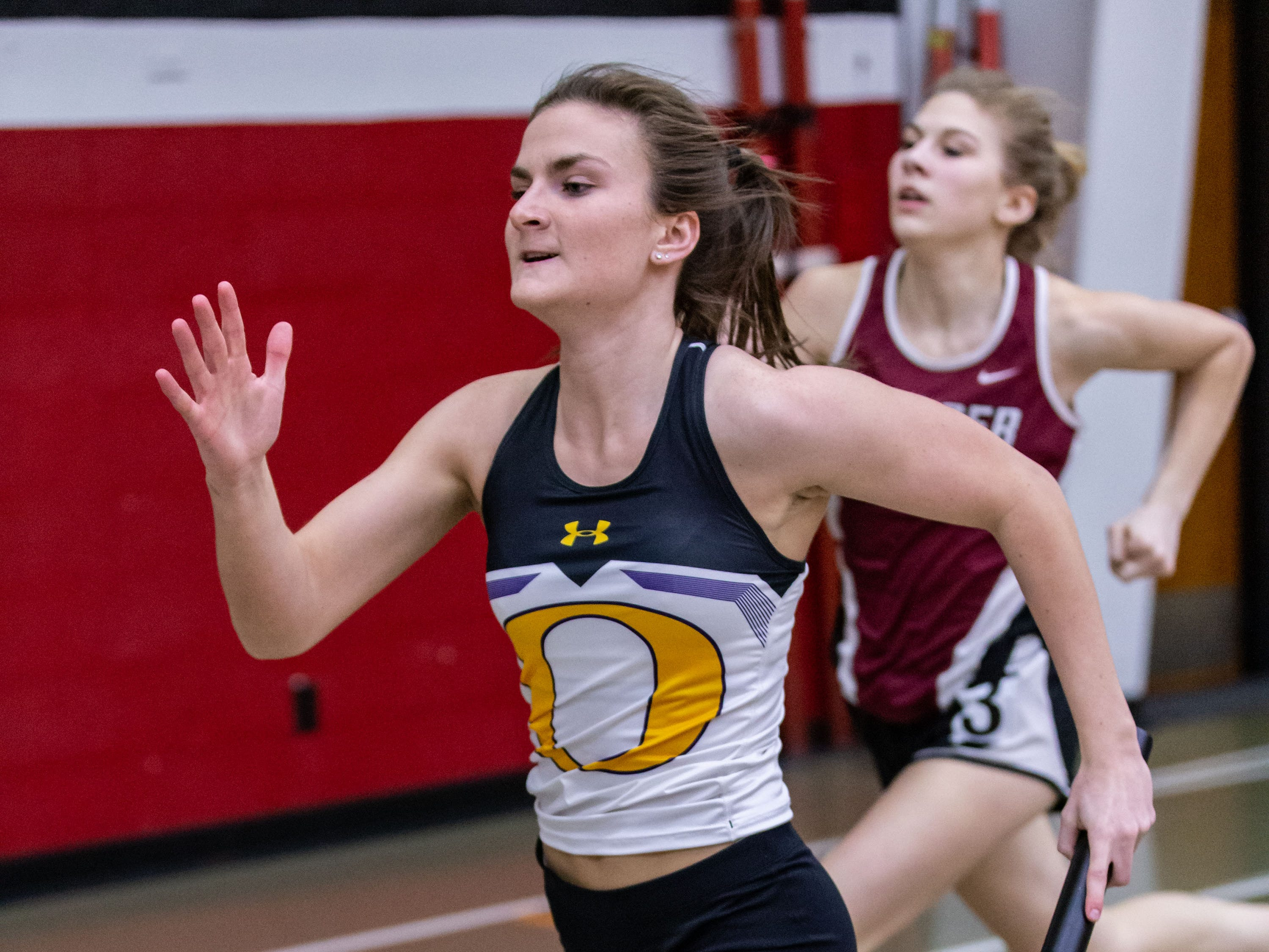 Oconomowoc's Grace Carini competes in the sprint medley relay at the Peter Rempe Cardinal Relays hosted by Waukesha South on Thursday, March 21, 2019.