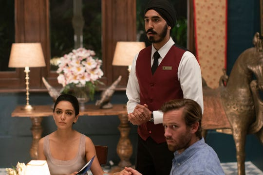 """Nazanin Boniadi (from left), Dev Patel and Armie Hammer find themselves caught up in a terrorist attack in """"Hotel Mumbai."""""""