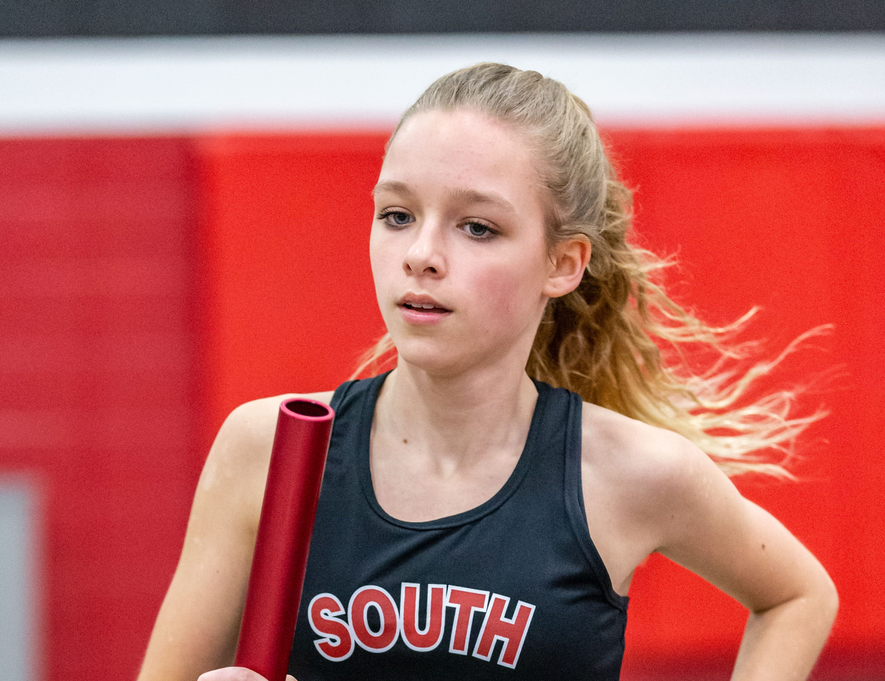 Waukesha South's Jenna Curley competes in the distance medley at the Peter Rempe Cardinal Relays hosted by Waukesha South on Thursday, March 21, 2019.