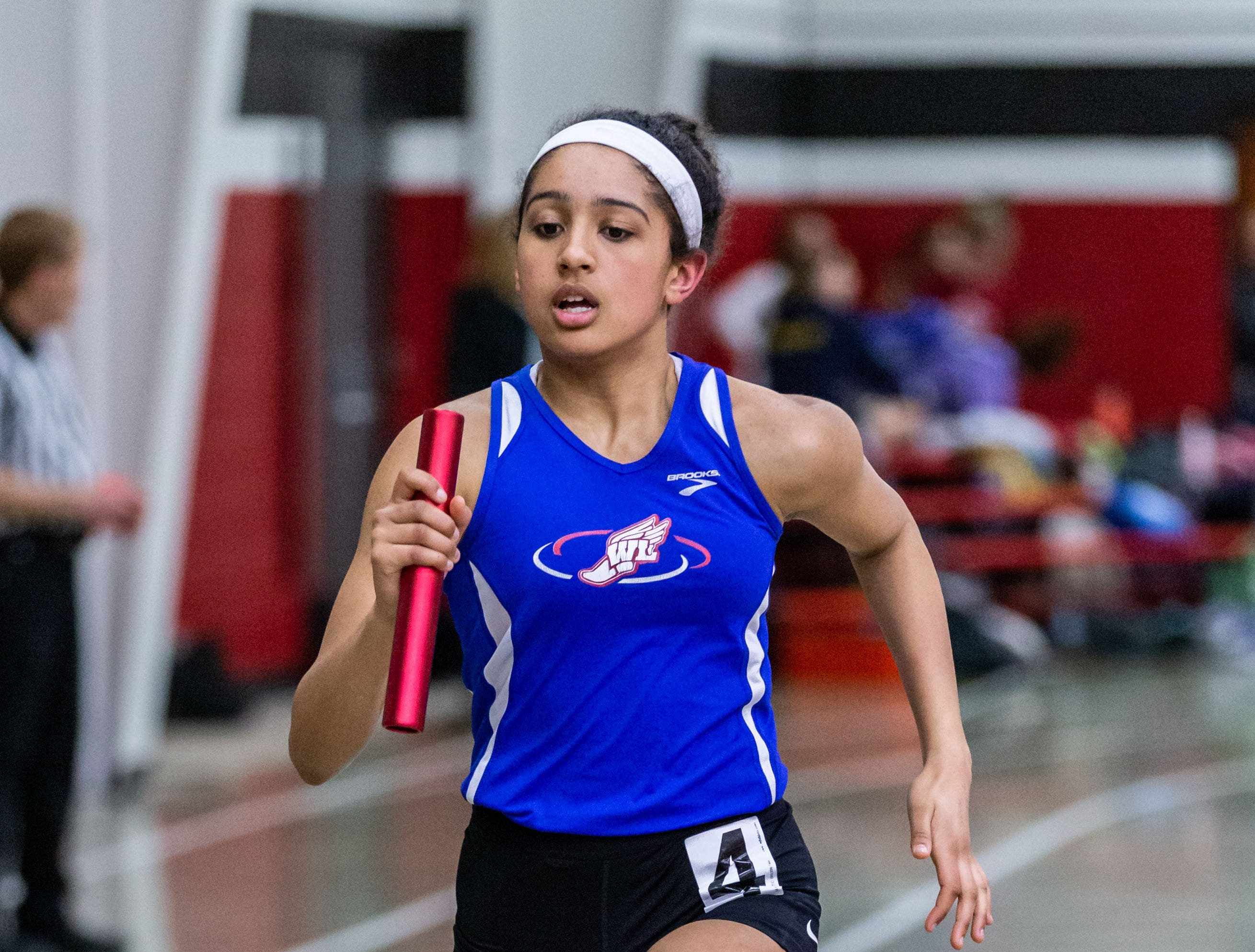 Wisconsin Lutheran's Kayla Wigley competes in the 4x440 yard relay at the Peter Rempe Cardinal Relays hosted by Waukesha South on Thursday, March 21, 2019.