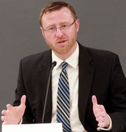 Wisconsin Supreme Court candidate Brian Hagedorn, a state appeals court judge, answers questions during a public forum on March 19 at the Milwaukee Bar Association.