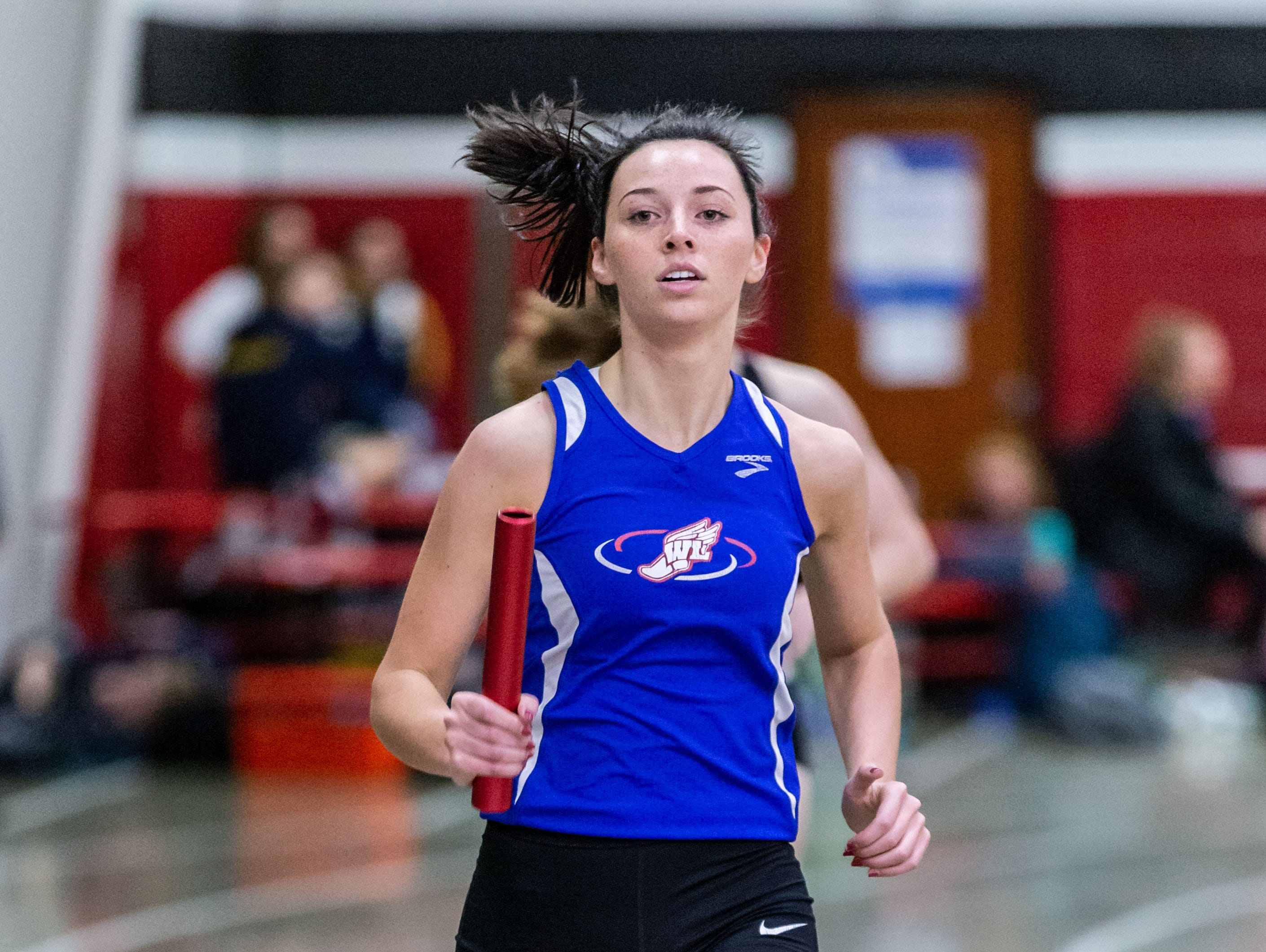Wisconsin Lutheran's Grace Beyer competes in the 4x440 yard relay at the Peter Rempe Cardinal Relays hosted by Waukesha South on Thursday, March 21, 2019.