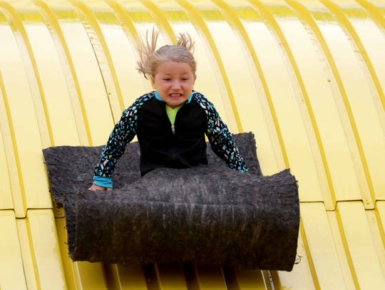 Kyra Bichler of Waukesha slides down the Giant Slide at the Wisconsin State Fair. 2018 was the 50th anniversary of the State Fair's Giant Slide.