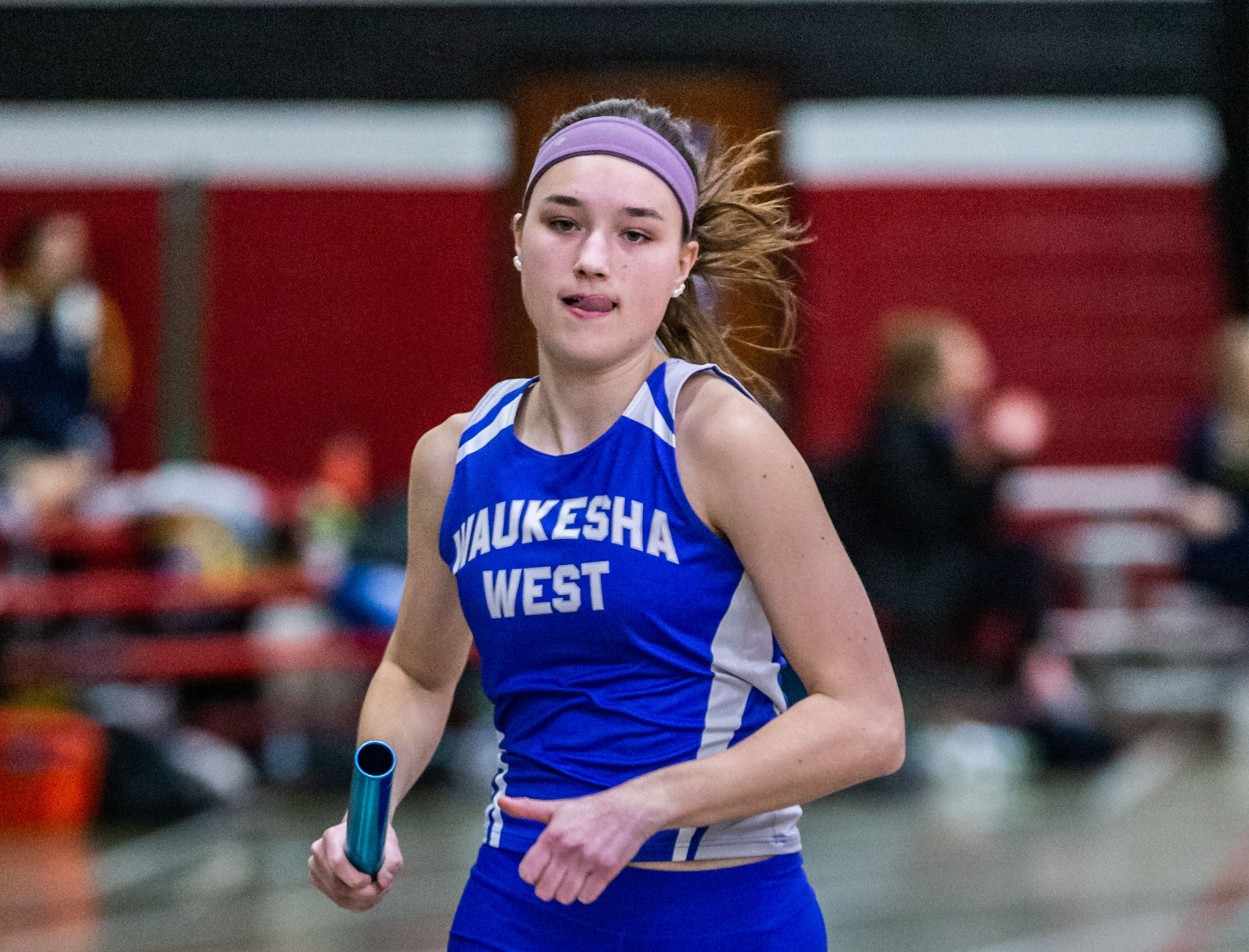 Waukesha West's Brooke Studnicki competes in the 4x440 yard relay at the Peter Rempe Cardinal Relays hosted by Waukesha South on Thursday, March 21, 2019. West won the event with a time of 4:21.90.