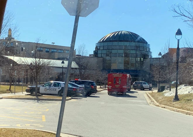 Police and fire vehicles in front of The Sister Joel Read Center at the Alverno College campus on Milwaukee's south side after the college was closed and evacuated.