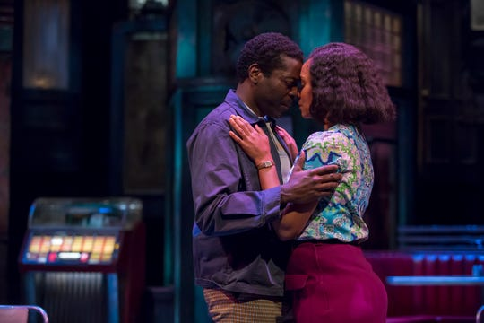 "Chiké Johnson and Malkia Stampley embrace in Milwaukee Repertory Theater's production of August Wilson's ""Two Trains Running."""