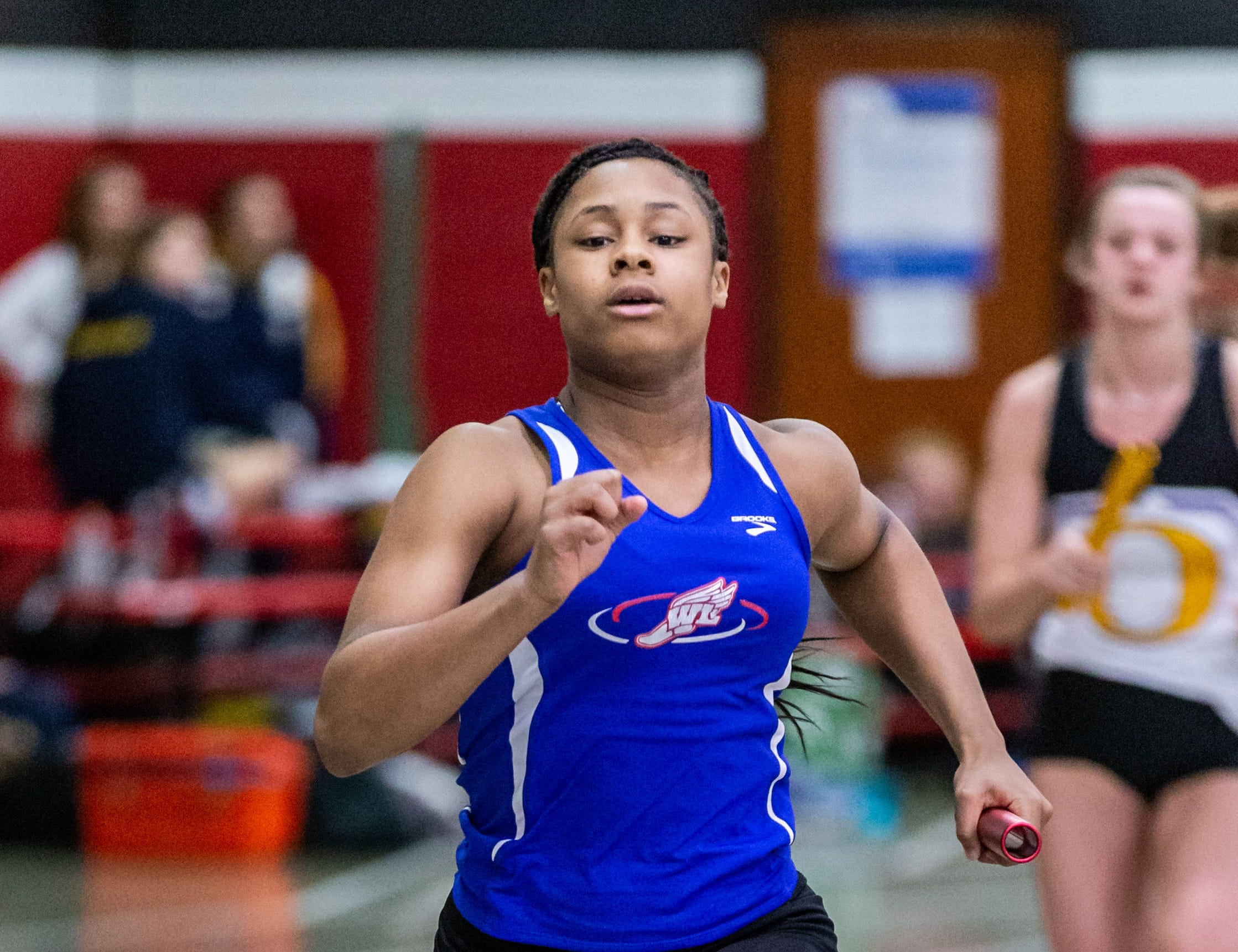 Wisconsin Lutheran's Deanna Campbell competes in the 4x440 yard relay at the Peter Rempe Cardinal Relays hosted by Waukesha South on Thursday, March 21, 2019.