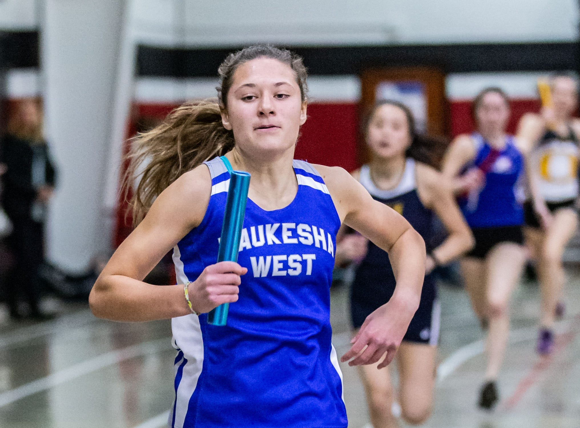 Waukesha West's Kaya Kuokkanen competes in the 4x440 yard relay at the Peter Rempe Cardinal Relays hosted by Waukesha South on Thursday, March 21, 2019.