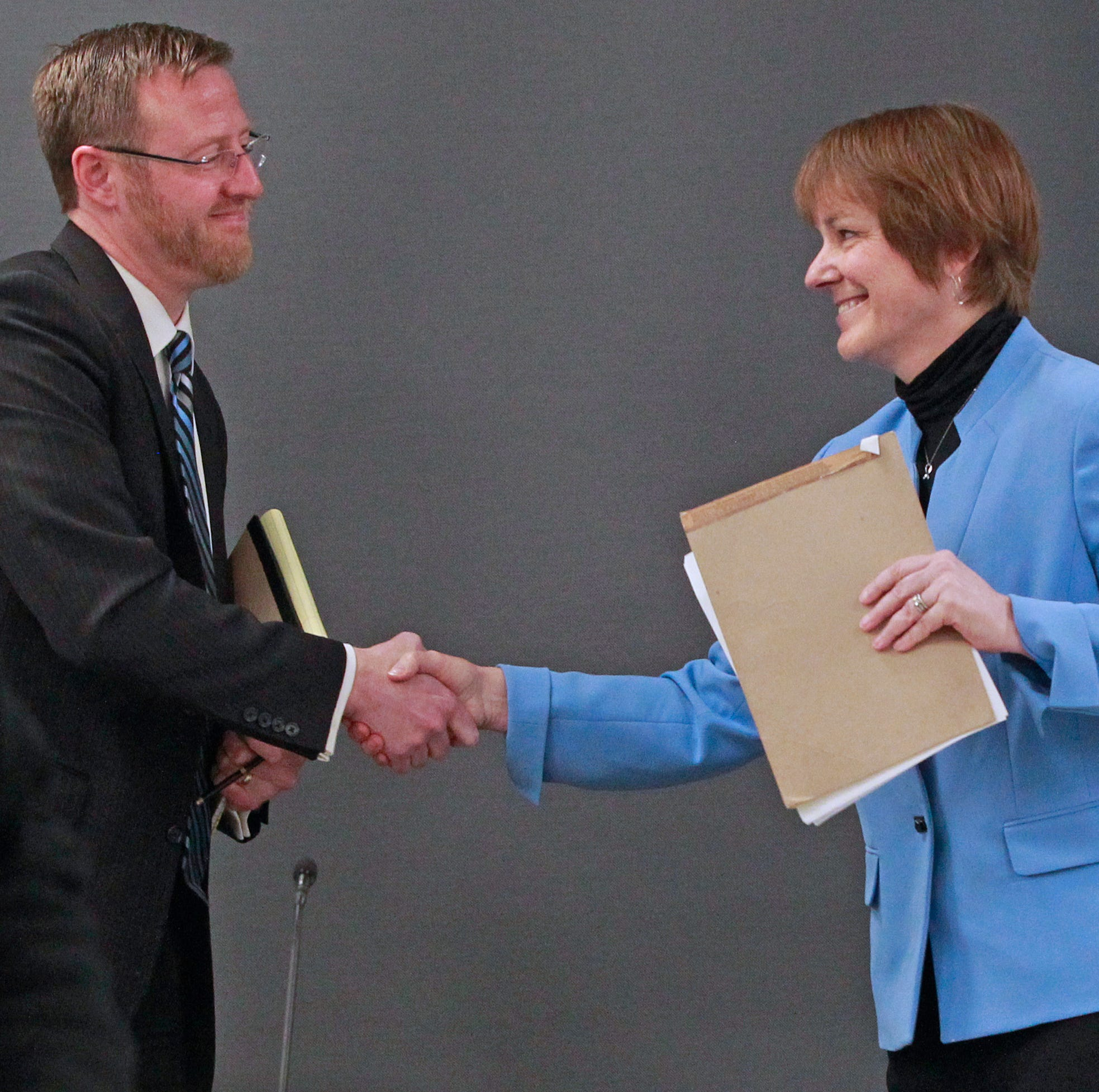 Wisconsin Supreme Court candidates Judge Brian Hagedorn, left, and Judge Lisa Neubauer, shake hands following their Tuesday forum at the Milwaukee Bar Association on March 19.