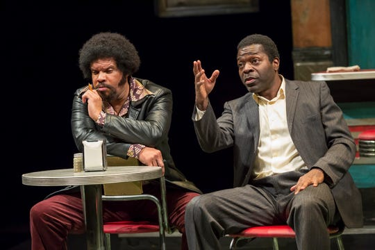"""Jefferson A. Russell and Chiké Johnson perform in Milwaukee Repertory Theater's production of August Wilson's """"Two Trains Running."""""""