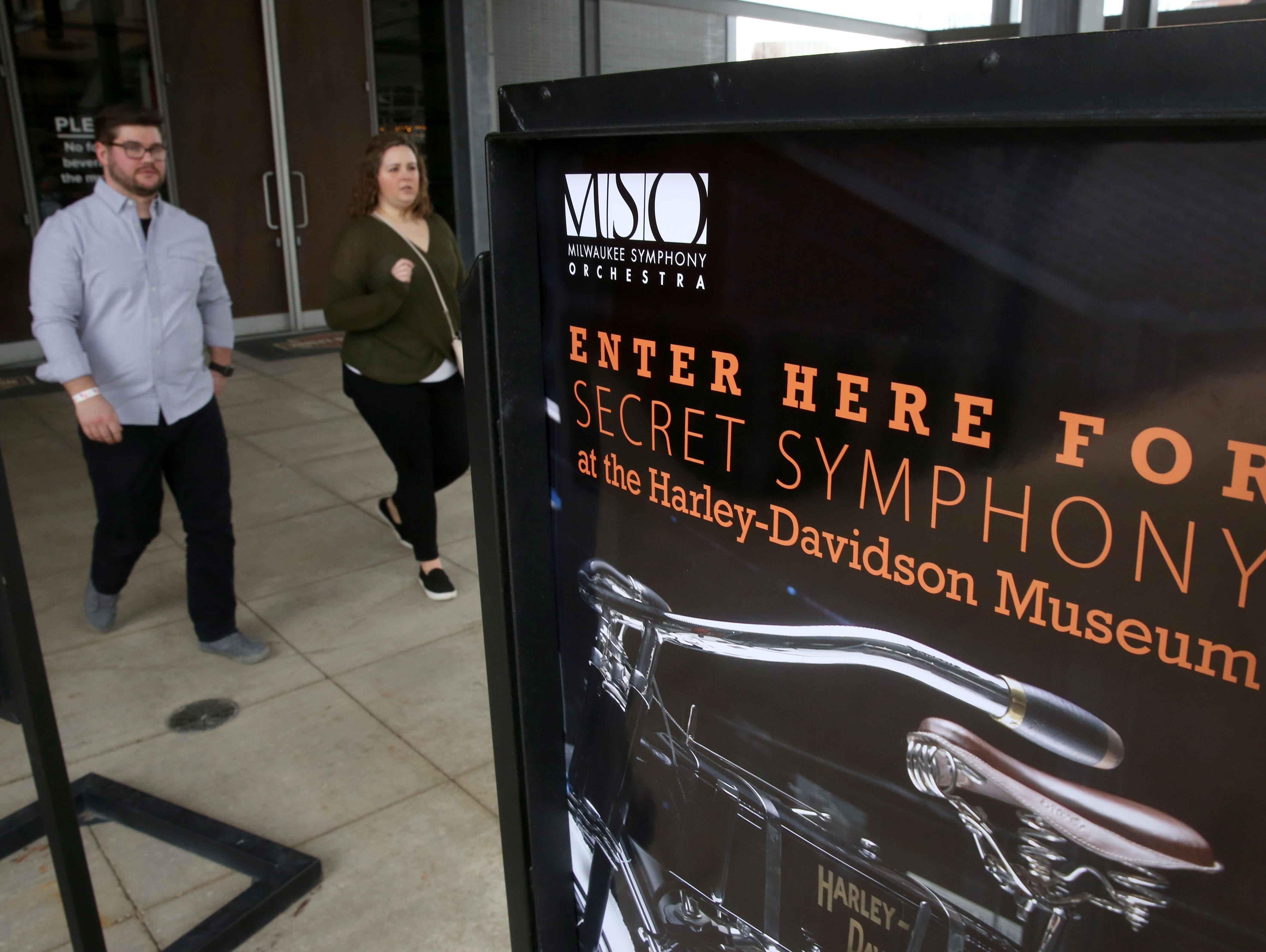 Adam Walkowski and Kelsey Endres enter the Harley-Davidson Museum for the Secret Symphony performance Sunday by the Milwaukee Symphony.