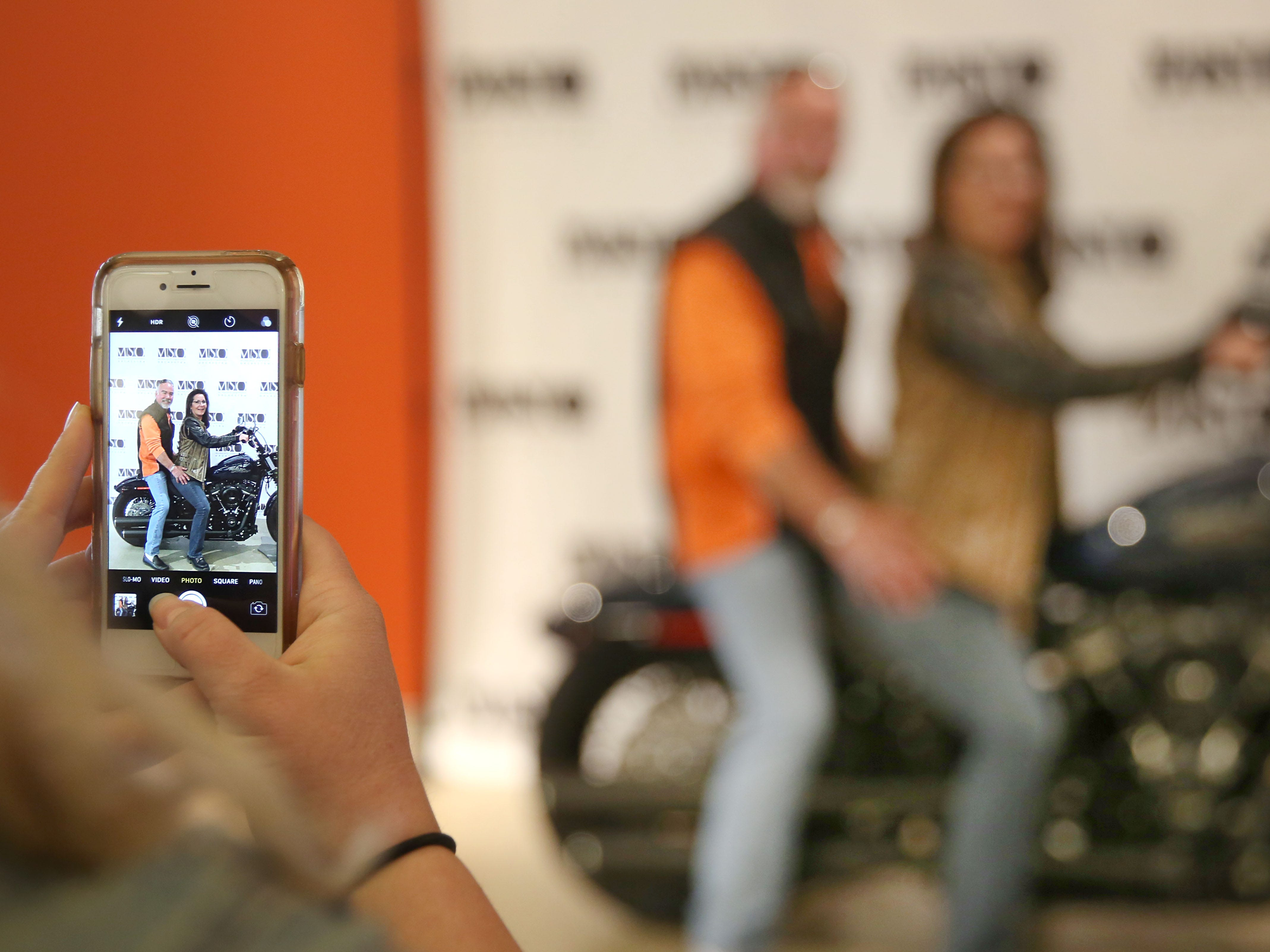 A friend's cell phone captures concertgoers Anne Casper and Bill (Wild Bill) Domenosky posing on a motorcycle before the Milwaukee Symphony's Secret Symphony performance at the Harley-Davidson Museum Sunday.