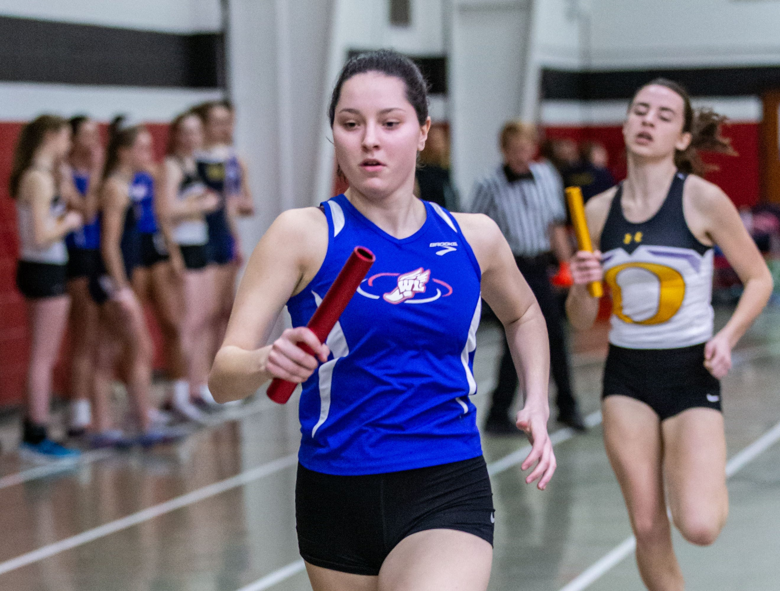 Wisconsin Lutheran's Emily Lohr competes in the 4x440 yard relay at the Peter Rempe Cardinal Relays hosted by Waukesha South on Thursday, March 21, 2019.