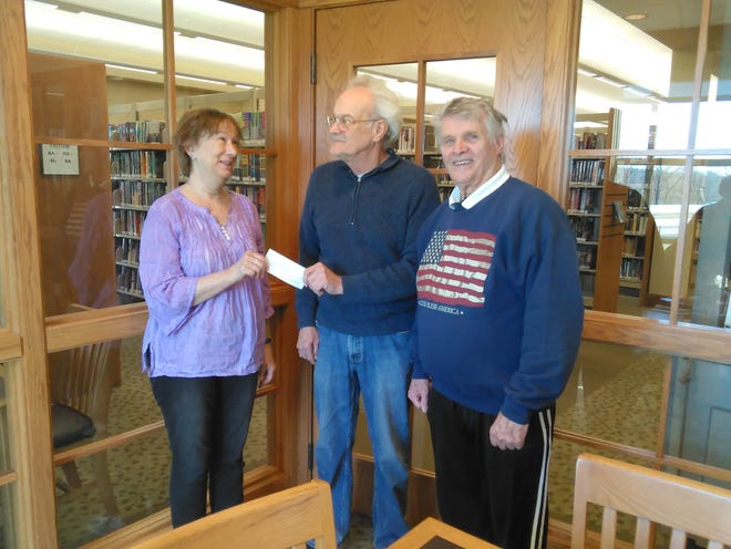 Deborah Lively (left), president of the White River Art Club, accepts a $500 check from Tim McClandsborough, president of the Bull Shoals Art Club, and Jerry Preator of the Bull Shoals Art Club. Not pictured: Lilly Dana, past president of the Bull Shoals Art Club.