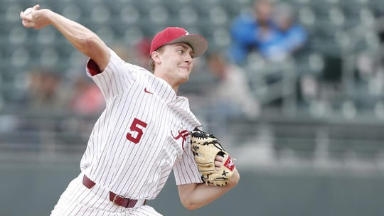 Alabama freshman pitcher Tyler Ras (No. 5) pitches in a game during the season-opening series against Presbyterian on Saturday, Feb. 16, from Sewell-Thomas Stadium in Tuscaloosa, Alabama. (Photo credit: Alabama athletic department)